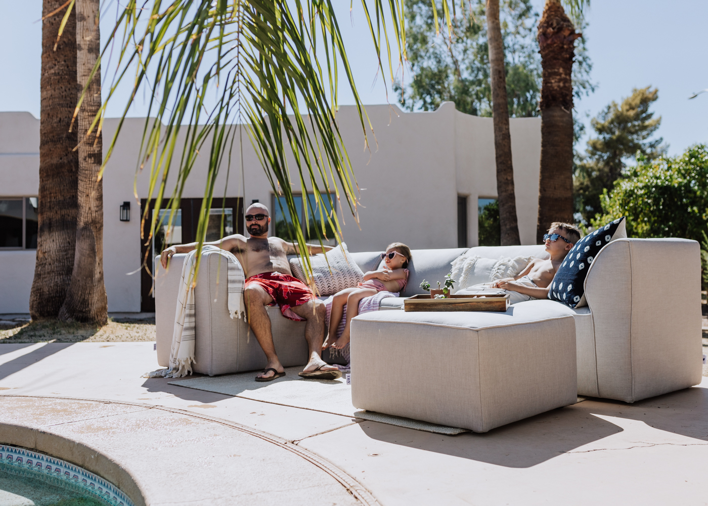 my favorite people enjoying our backyard in the late summer heat | thelovedesignedlife.com #summer #poolside #arizona