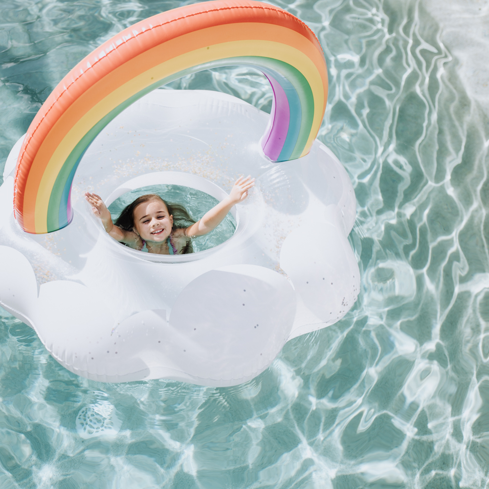 late summer swimming in our backyard | thelovedesignedlife.com #summer #rainbow #poolfloat