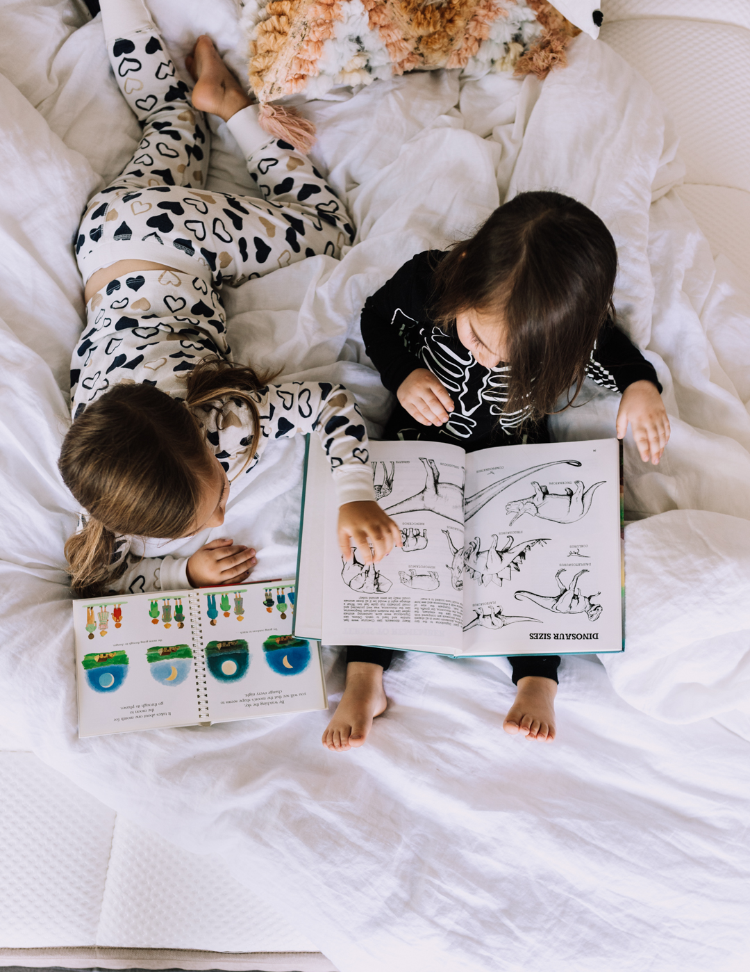 reading together in bed, one of our favorite bedtime rituals | thelovedesignedlife.com #bedtimerituals #dreamcloudsleep