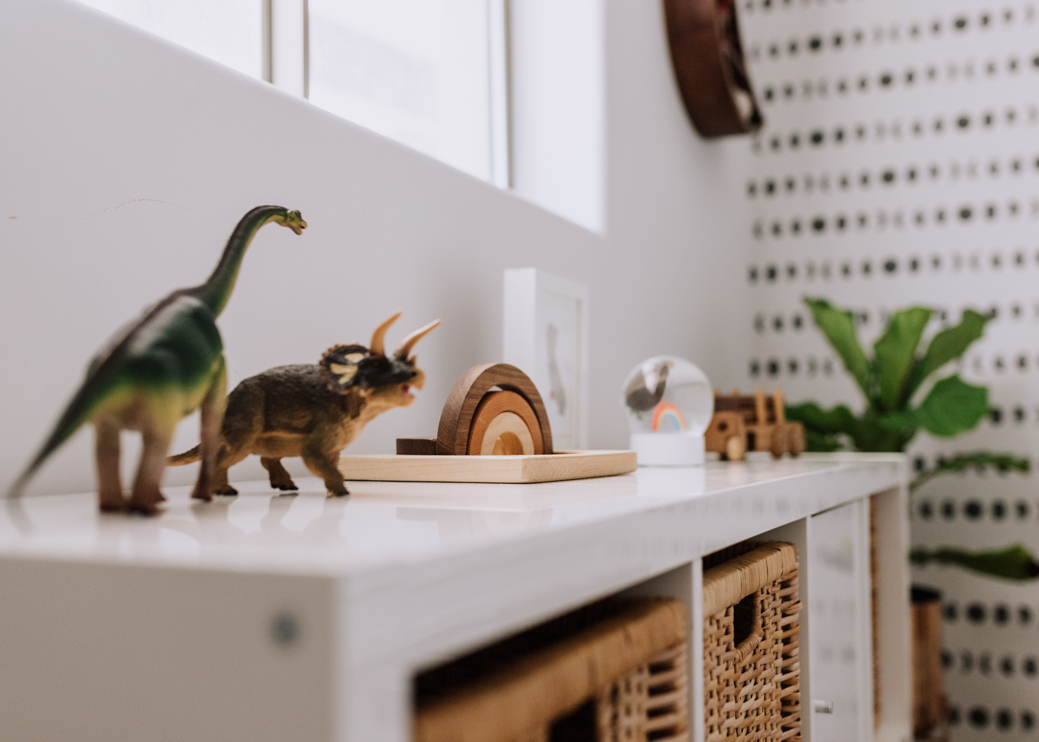 cutest little toys in boho modern playroom | thelovedesigendlife.com #playroom #kidsroom #dinosaurs