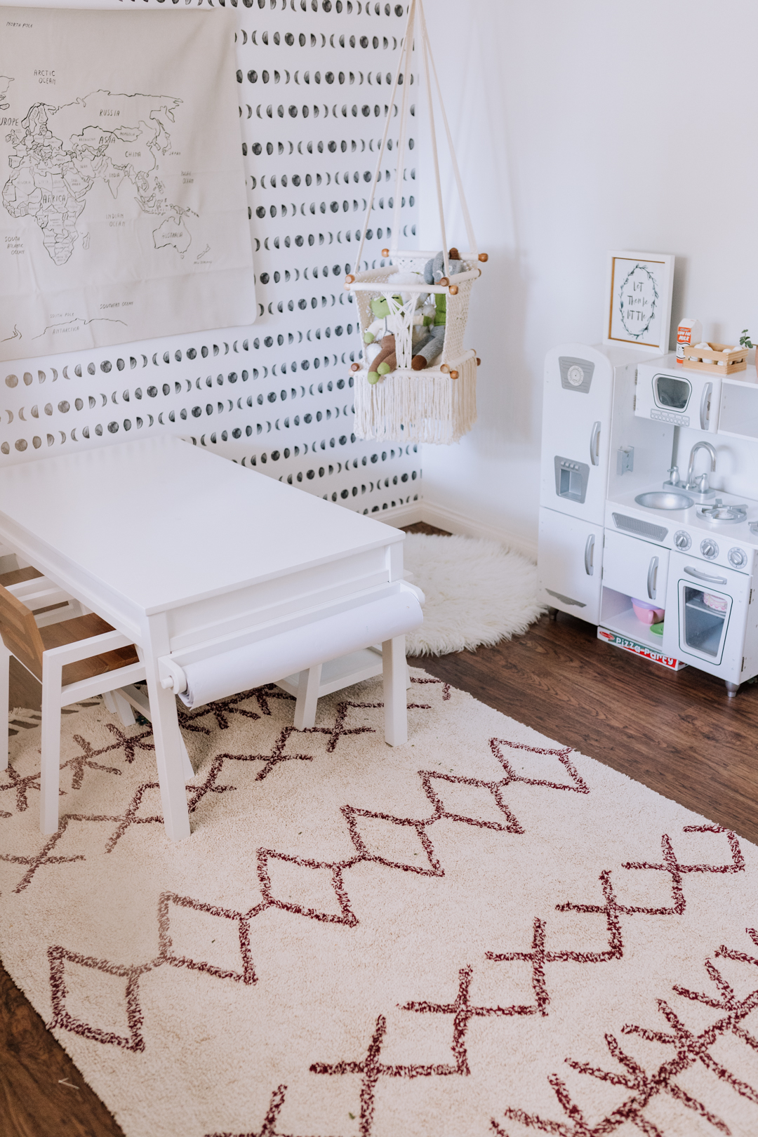 darling modern playroom in a small space | thelovedesignedlife.com #playroom #macrame #playkitchen