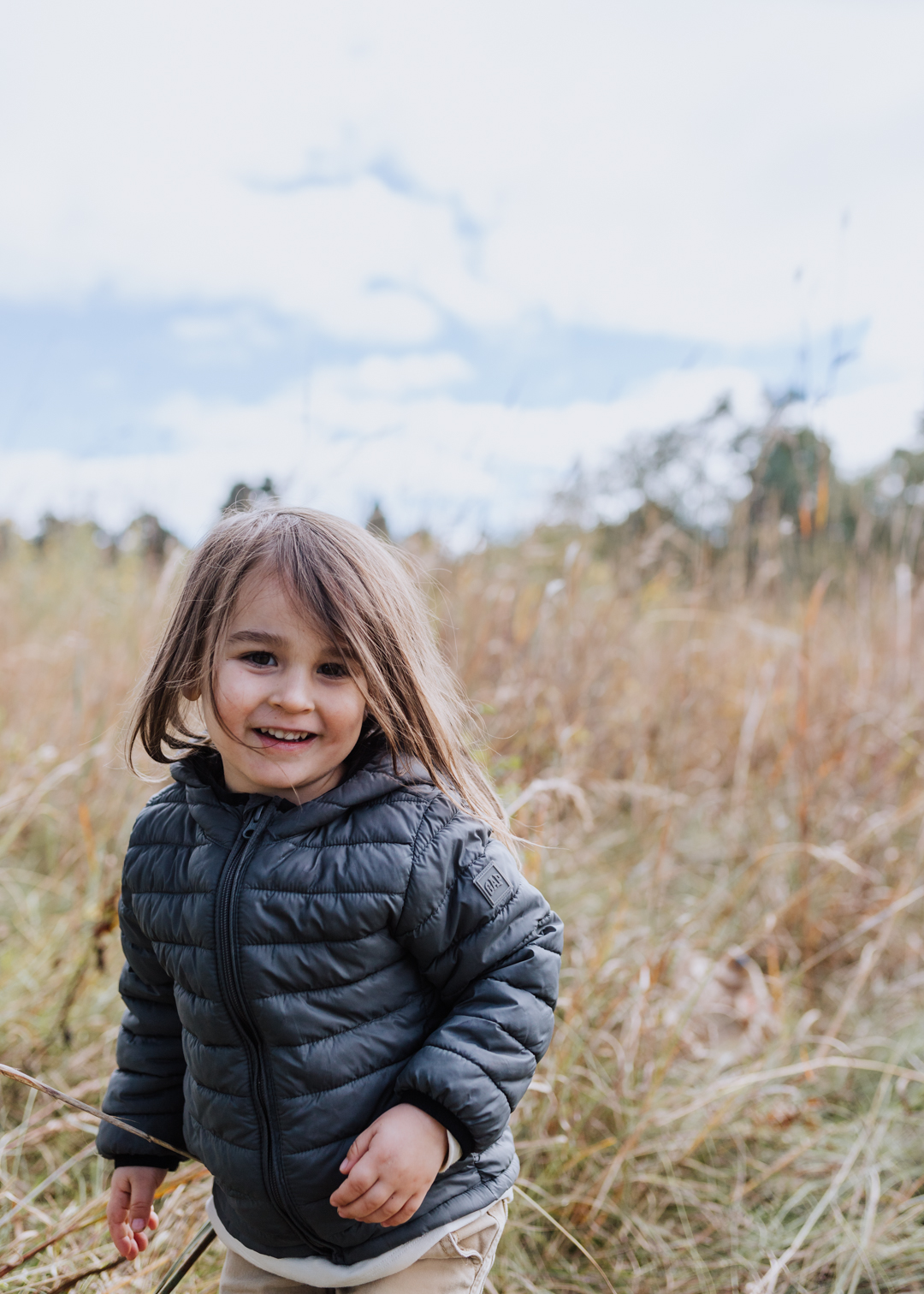 cutie pie in an open field in south dakota | thelovedesignedlife.com #fall #southdakota #childhood