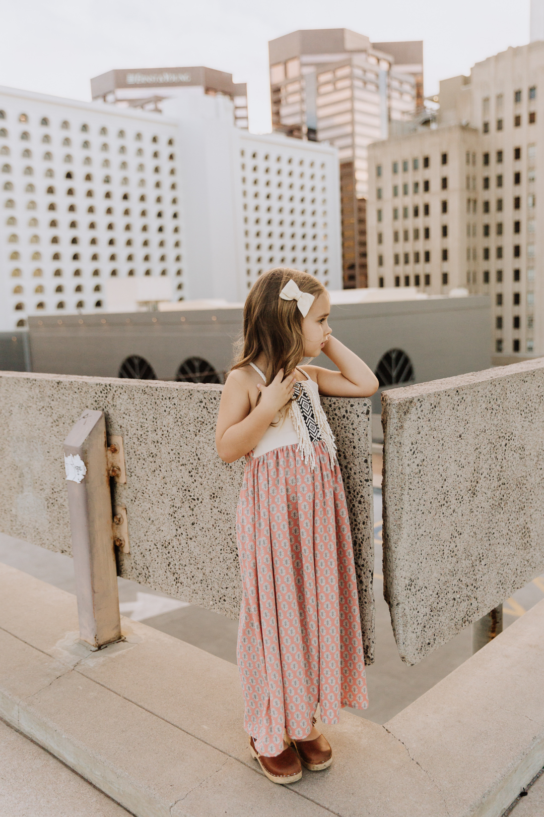 our sweet girl on a rooftop for family photos | thelovedesignedlife.com #ministyle #familyphotos