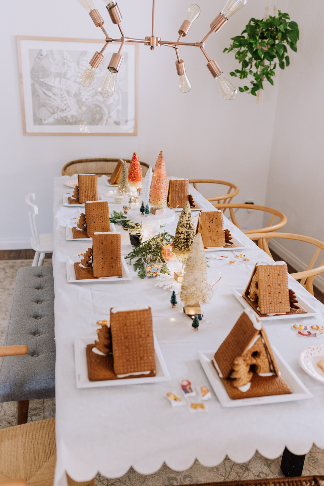 all of the gingerbread houses lined up, ready to decorate! | thelovedesignedlife.com #holidays #gingerbreadhouse #christmastime #baking #holidaypartyidea