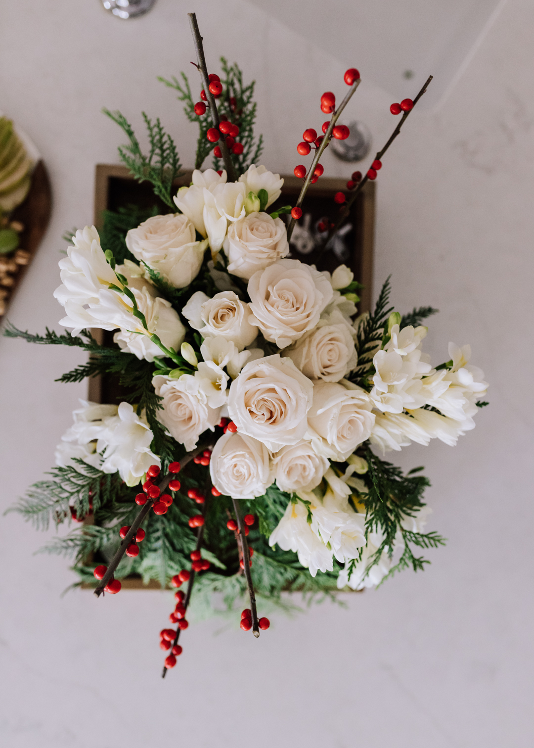 gorgeous DIY holiday flowers for a simple holiday party | thelovedesignedlife.com #holidayparty #flowers #christmas #gingerbreaddecorating