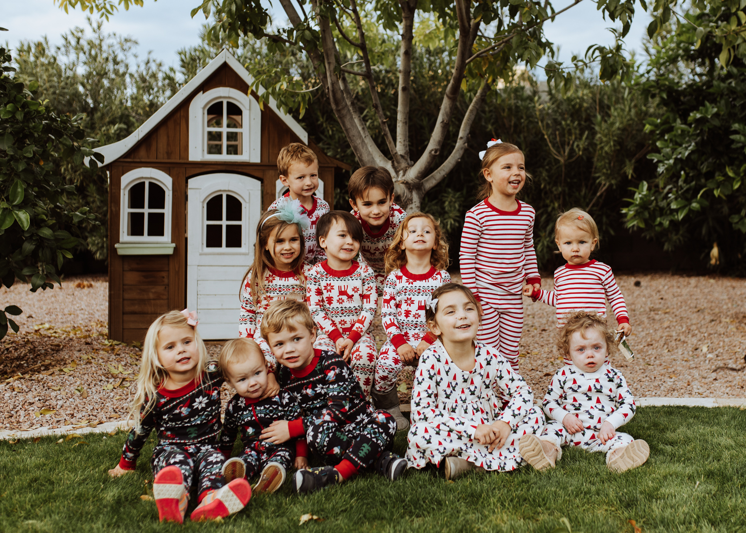 some of my besties kids, all in matching christmas pajamas for our gingerbread decorating party! | thelovedesignedlife.com #matchingjammies #christmasjammies #hannajams #gingerbreadhouse #holidayplaydate