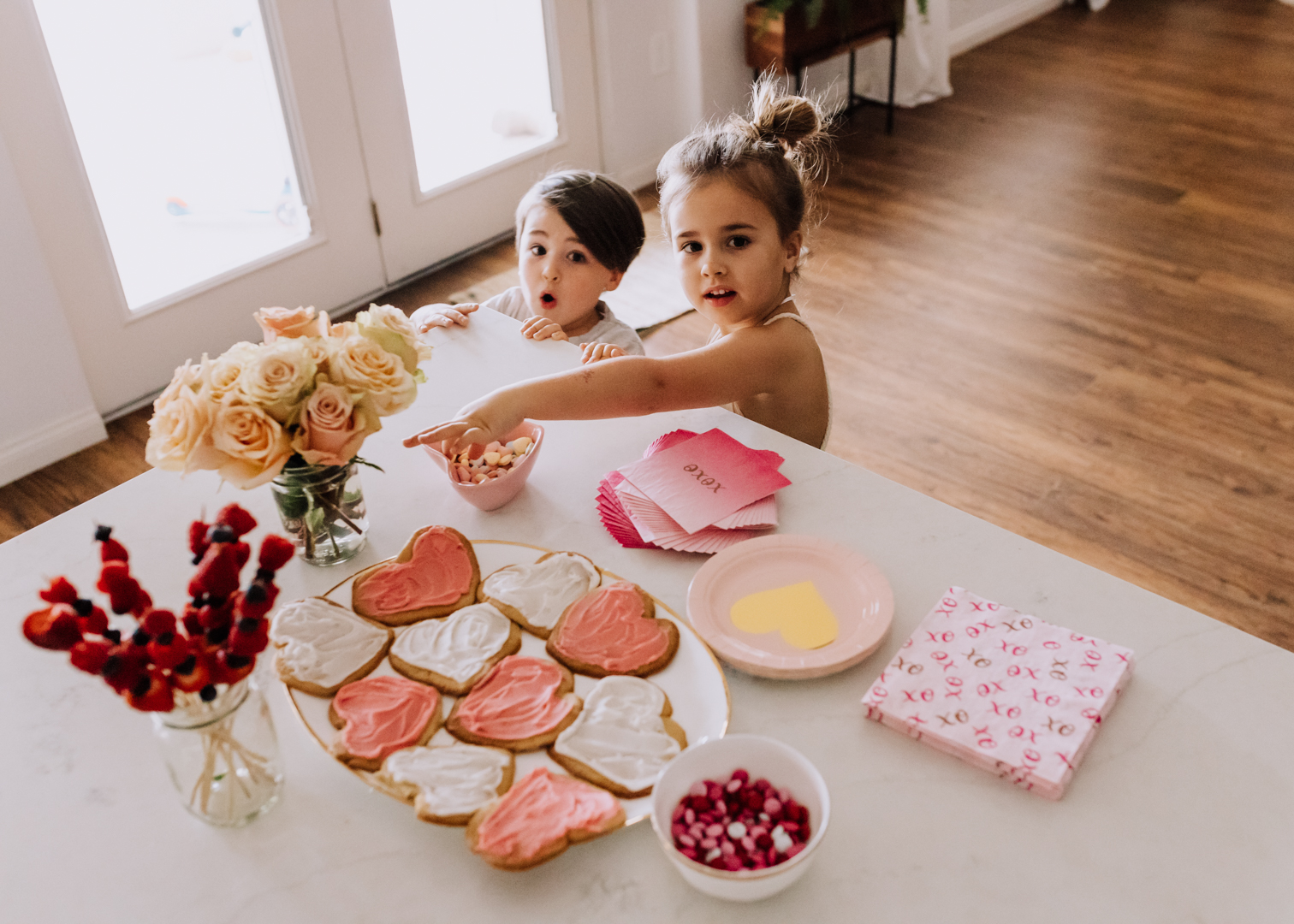 these two are just here for the valentine's heart shaped treats | thelovedesignedlife.com #valentinesday #party