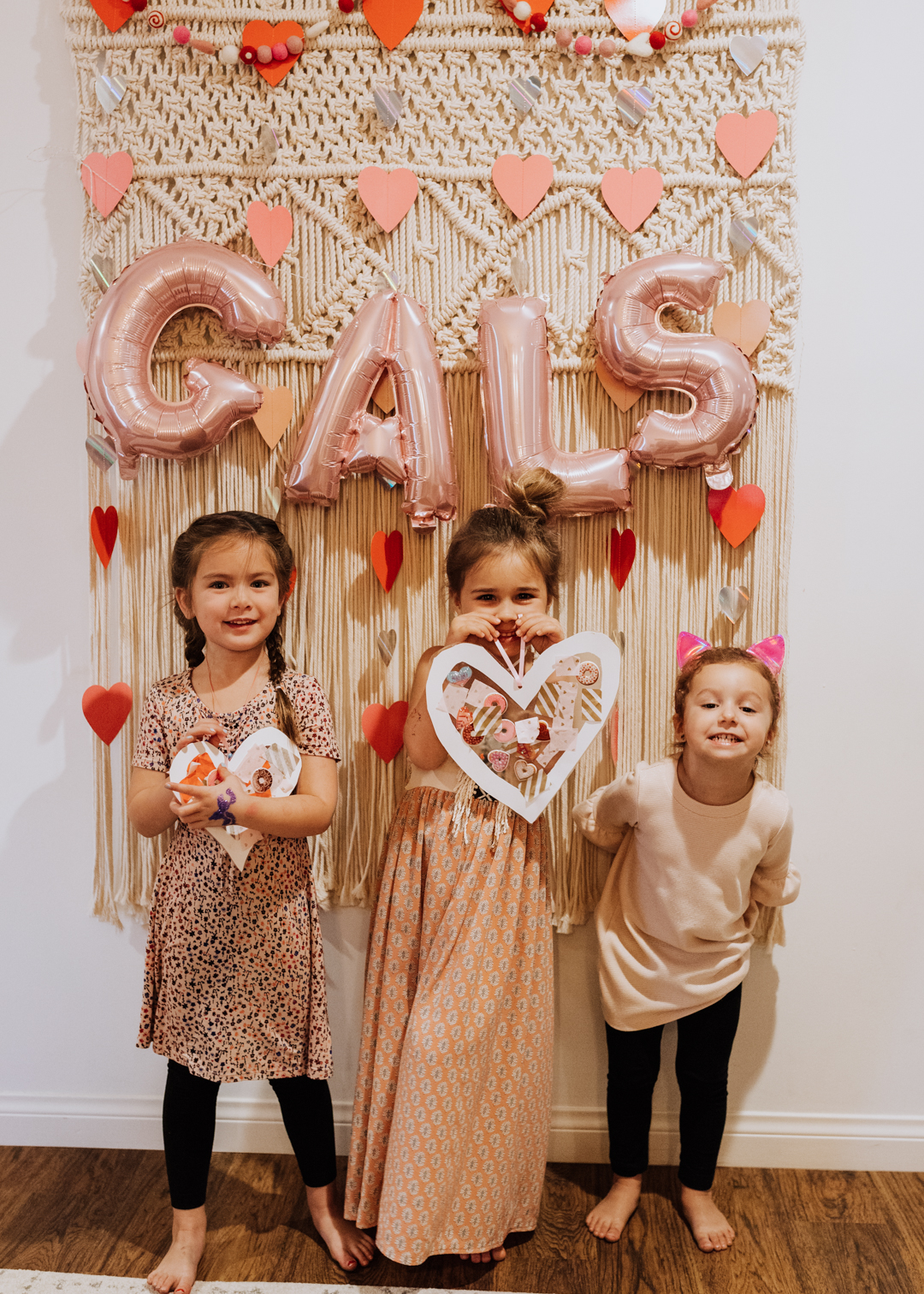 gals with their finished suncatcher heart | thelovedesignedlife.com #heartcraft #suncatcher #galentines