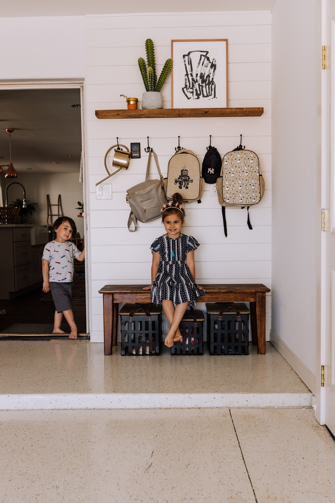 coming home from school, the kids hang their backpacks in the garage | thelovedesignedlife.com #thedailymoments #home #garageorganization #interiordesign
