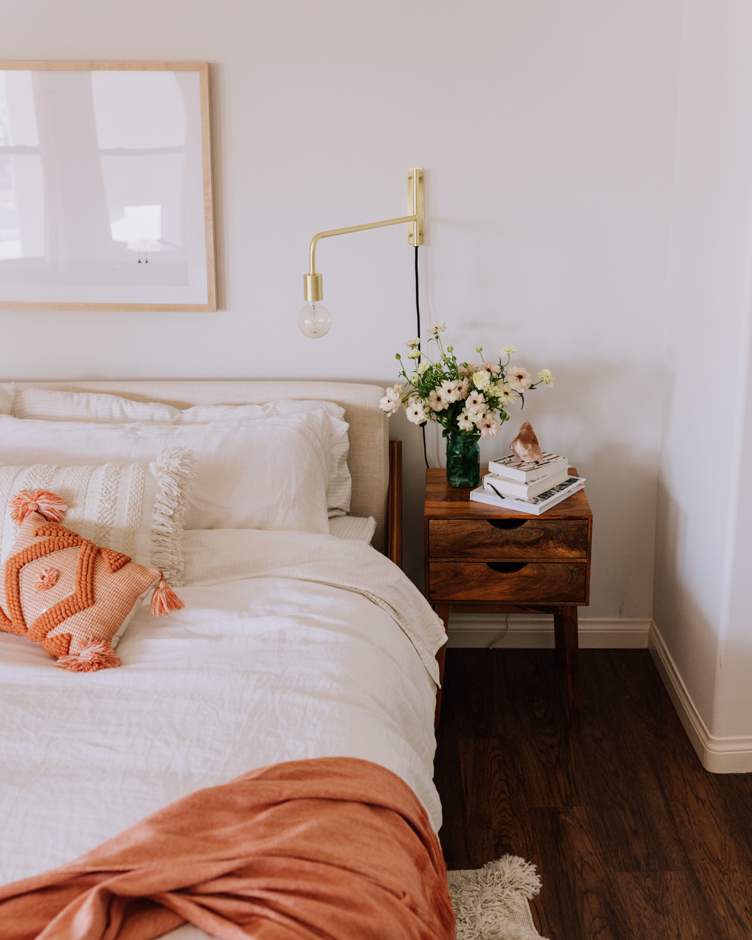 a bed made to start the day, and flowers on the nightstand! | thelovedesignedlife.com #bedrrom #morningroutine