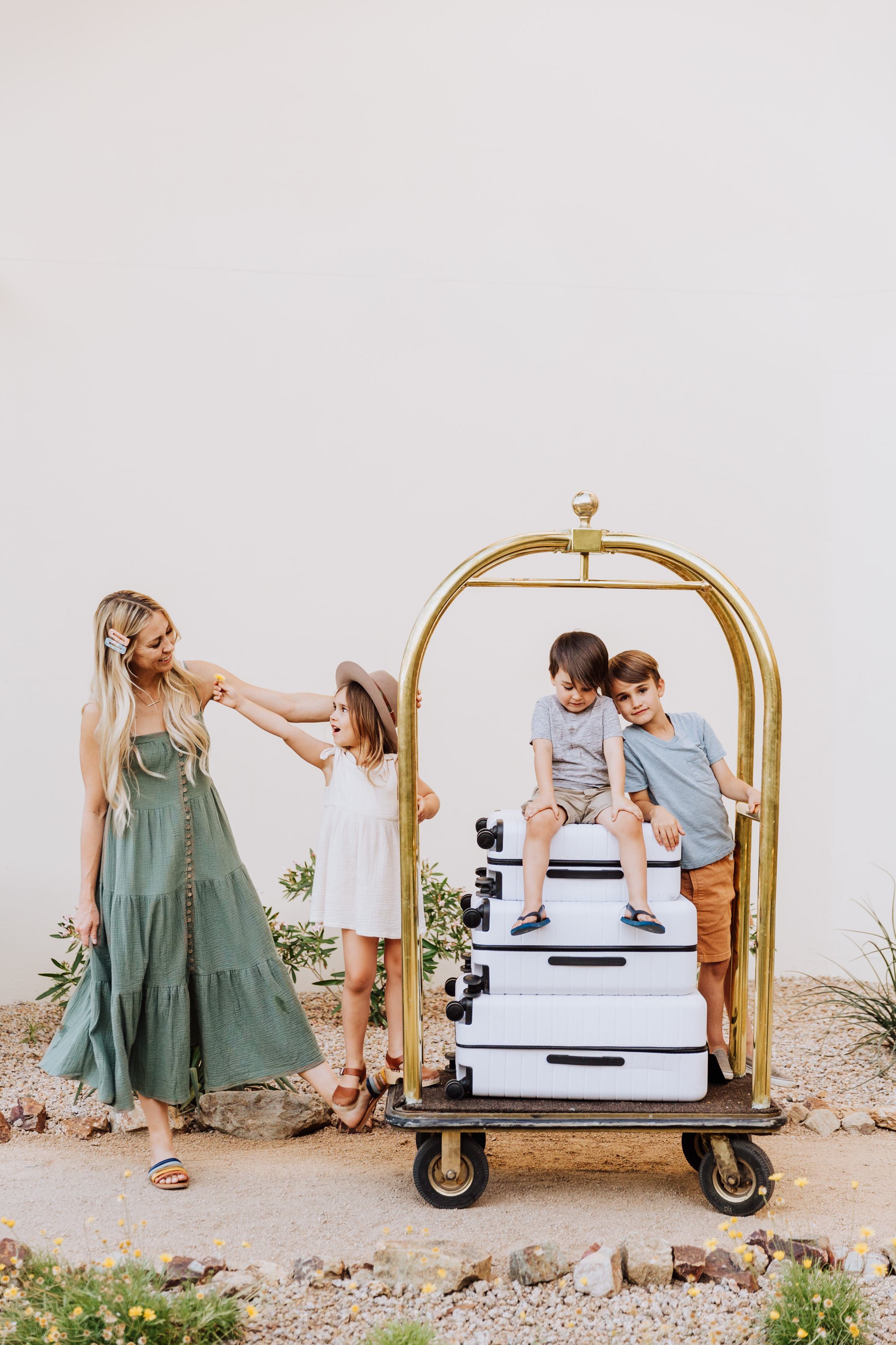 summer travel ready with suitcases and a hotel bellhop