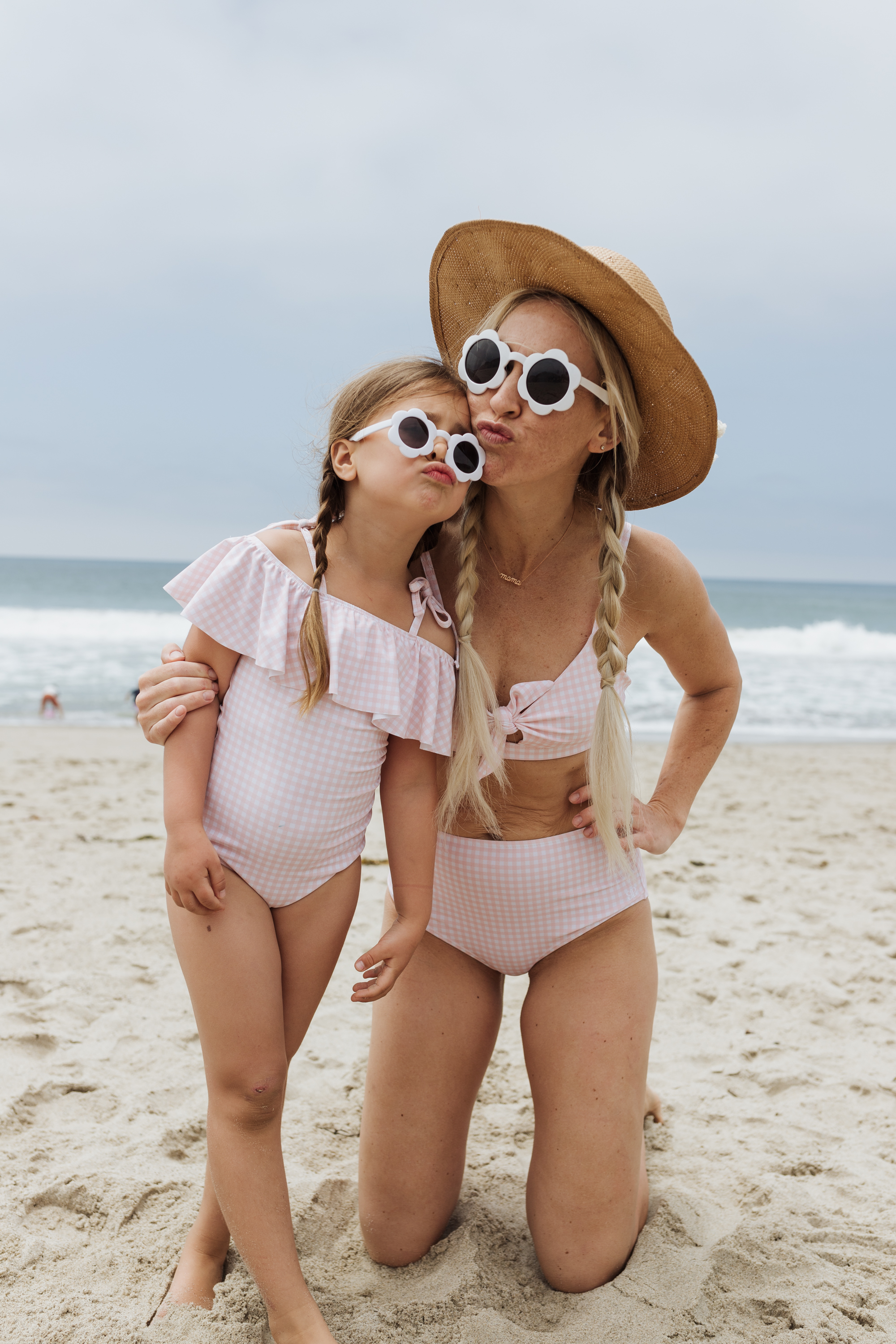 mom and daughter in matching pink swimsuits