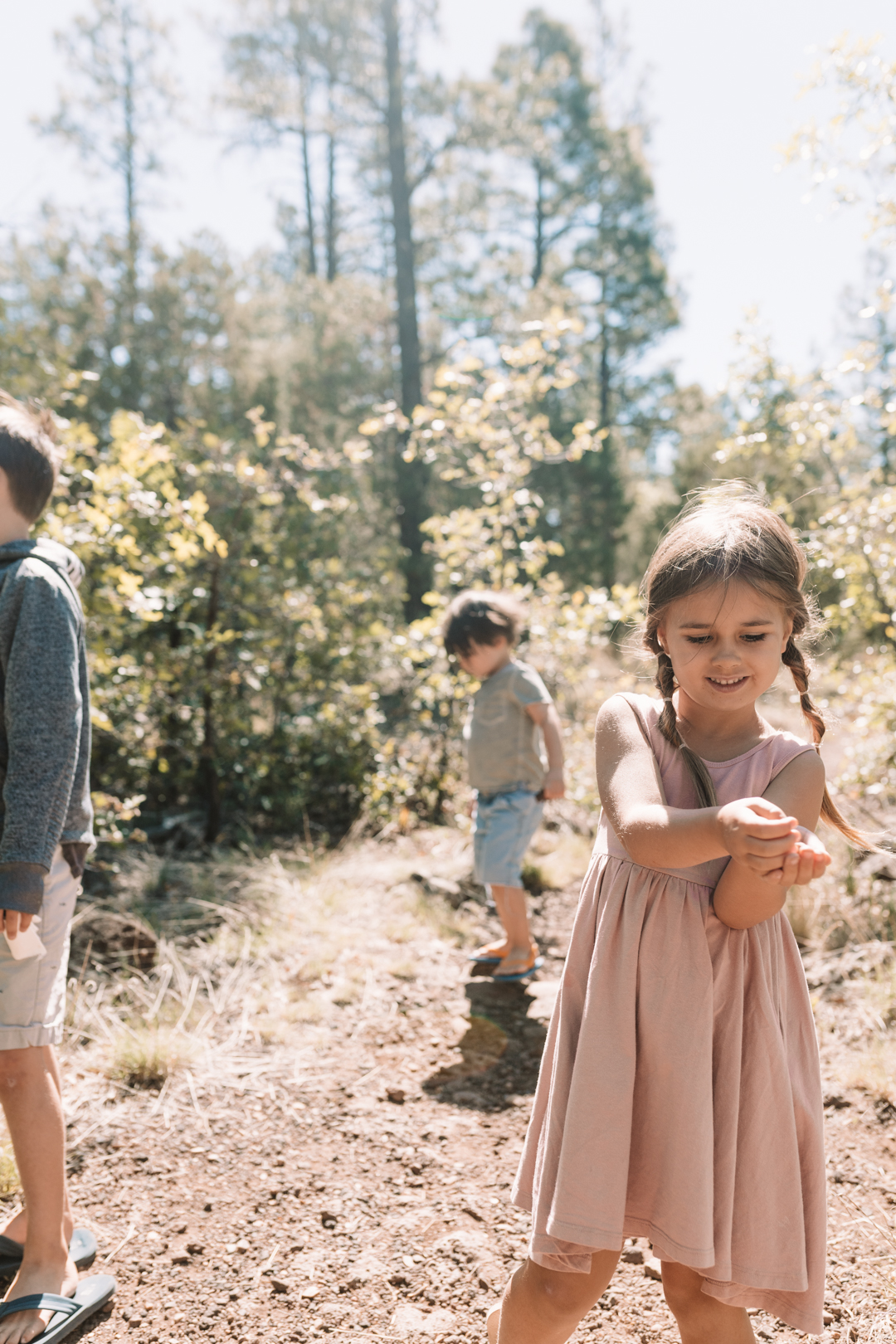 3 kids on a walk in the woods