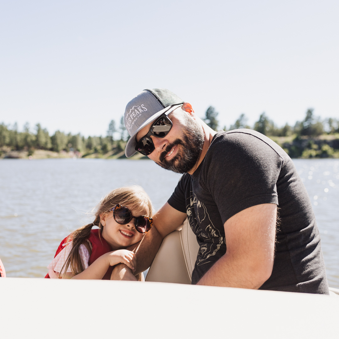 dad and daughter on a boat