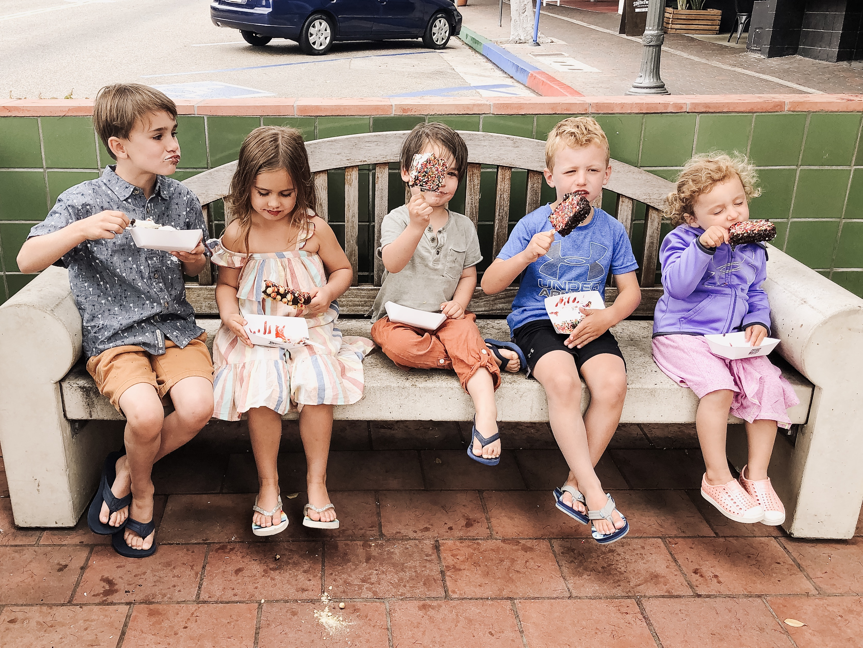 5 kids eating ice cream in a beach town, california
