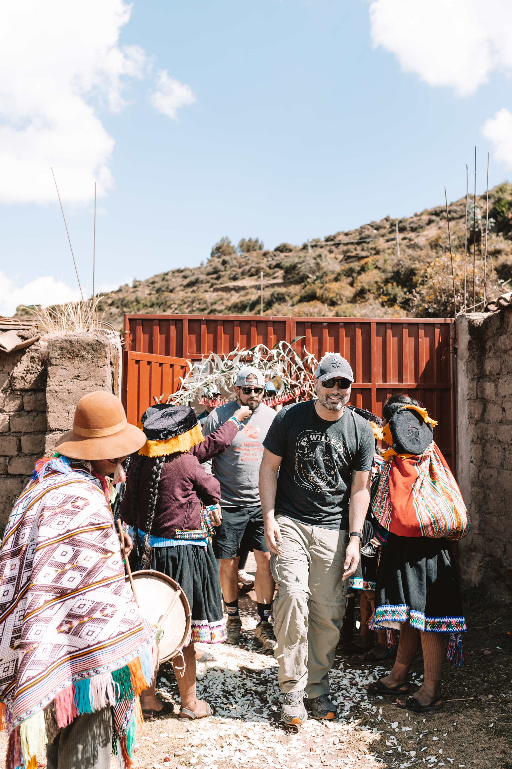 arriving at the school in the Andean Mountains and being greeted by a traditional ceremony and flower petals thrown on our heads #peruretreat #wanderlust #travel