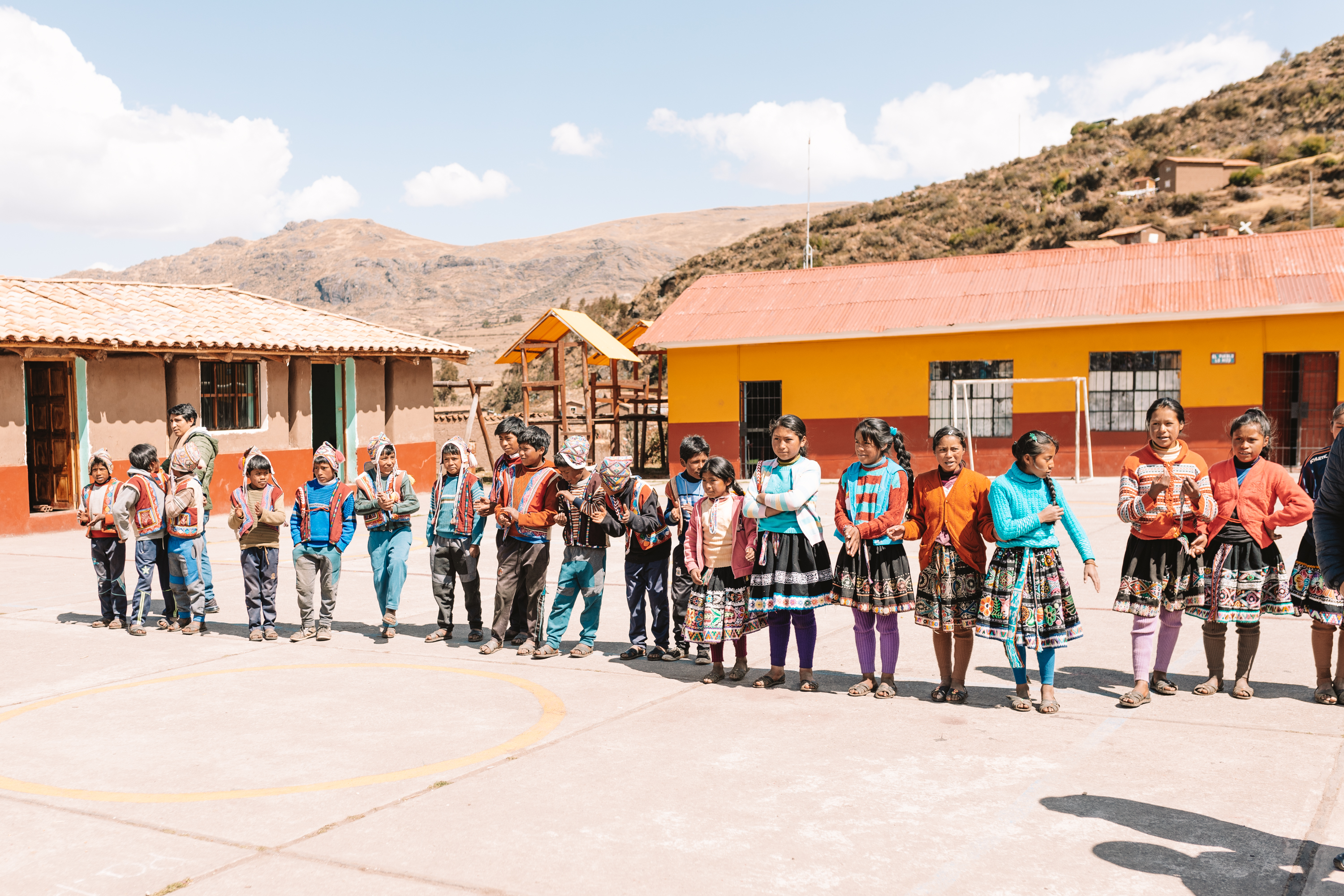 a ceremony at a local Quechuan school in Peru #magicaljourney #peru