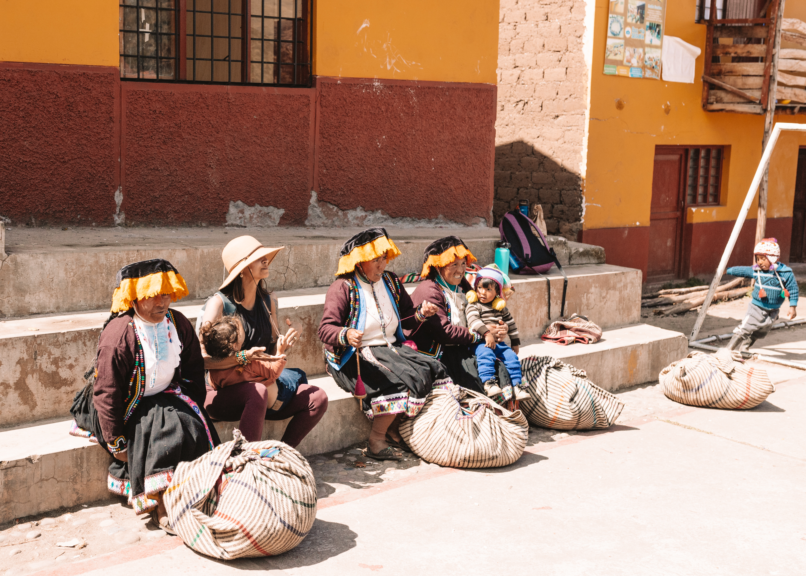 mothers of different cultures, sitting together as one #peru #motherhood