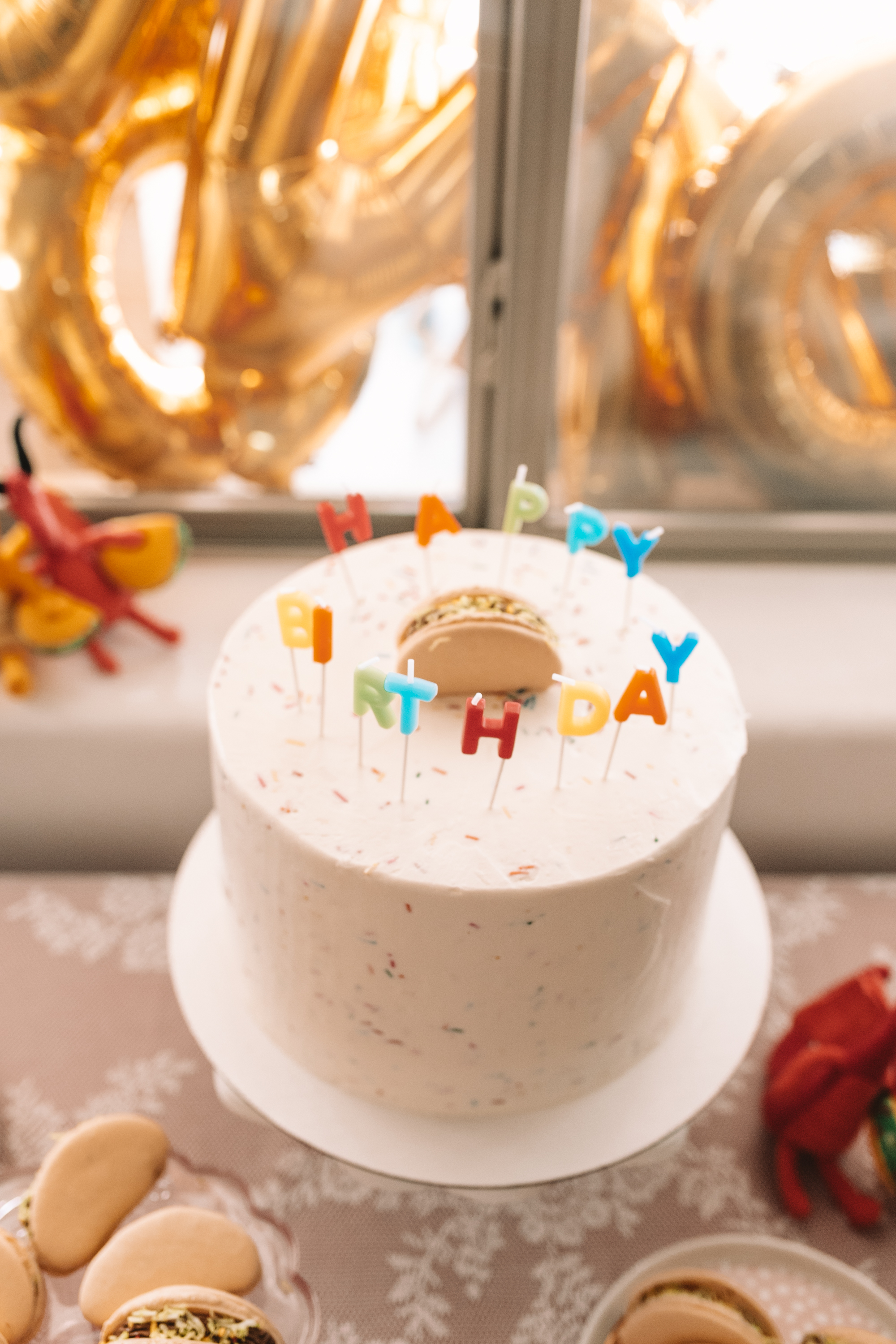 the perfect funfetti cake with a taco macaroon on top.