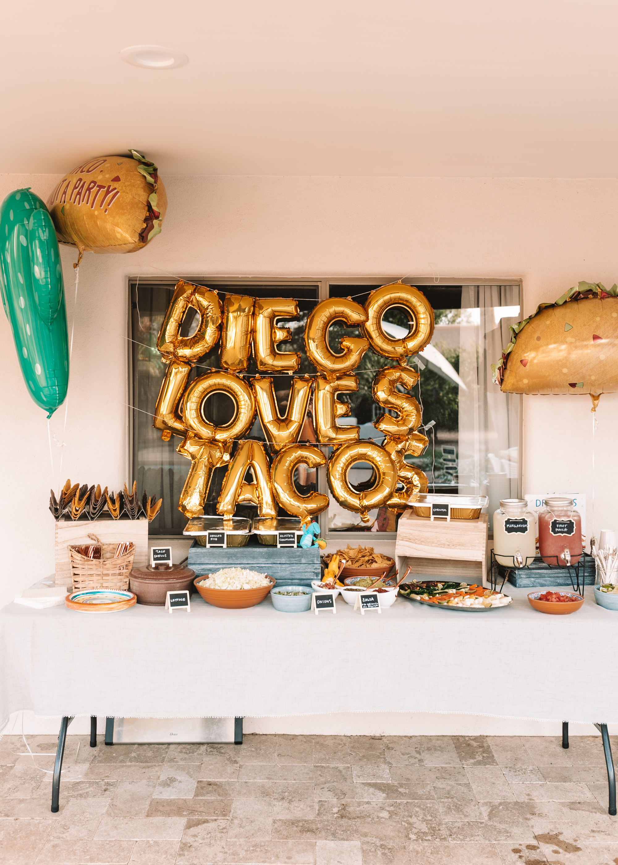 taco bar for a dragons love tacos birthday party.