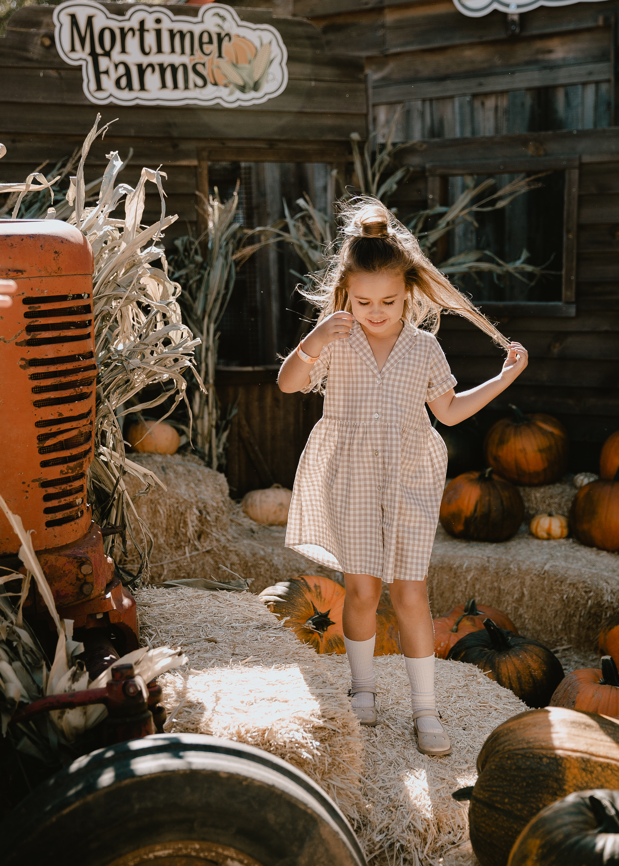 I love this sweet Rylee & Cru dress on my little girl. Perfect for our pumpkin patch visit! #fallfun #pumpkinpatch #ministyle
