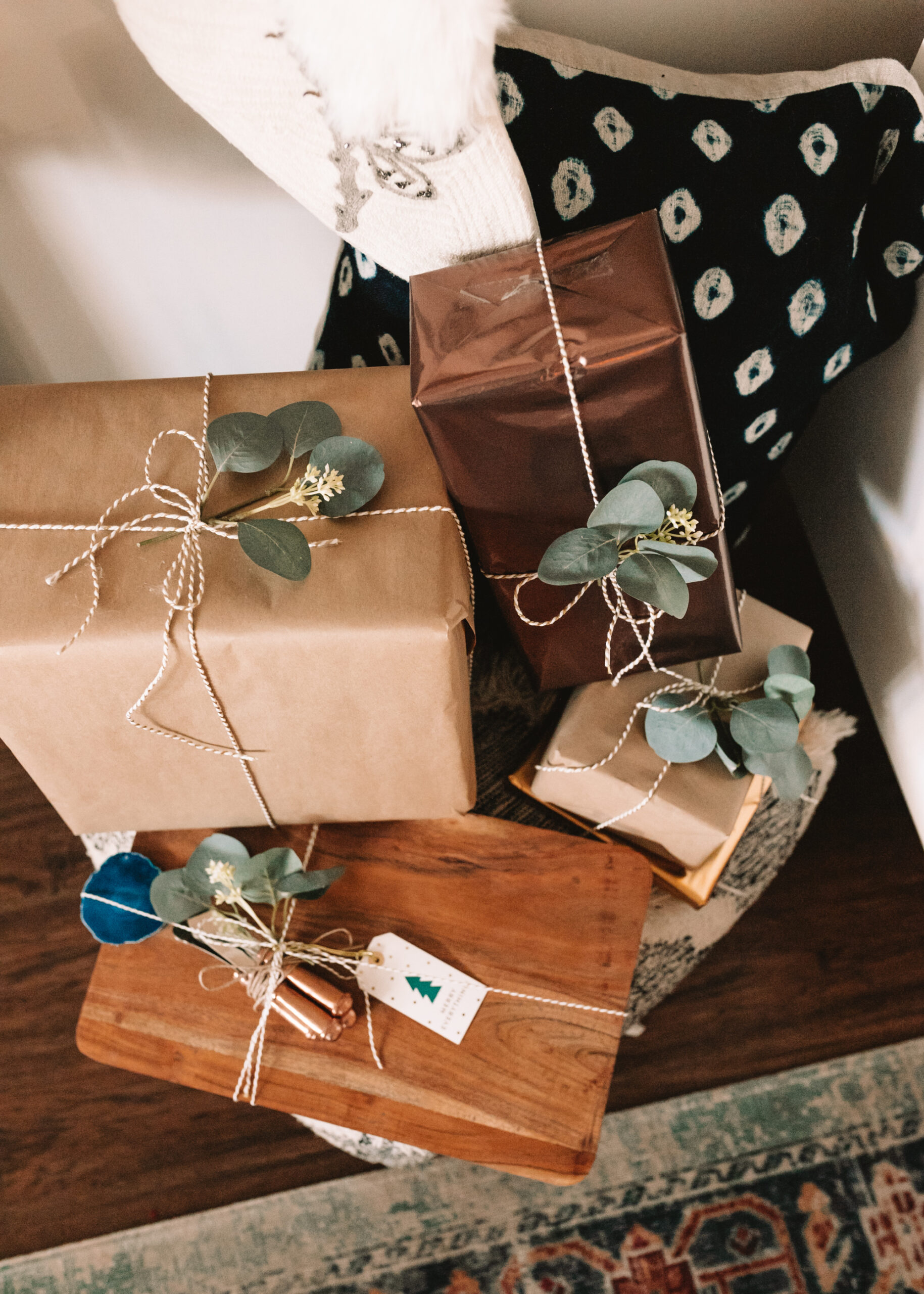 brown paper packages tied up with strings, all ready for holiday gifting! #thelovedesignedlife #holidaygiftguide #wrappingpaper