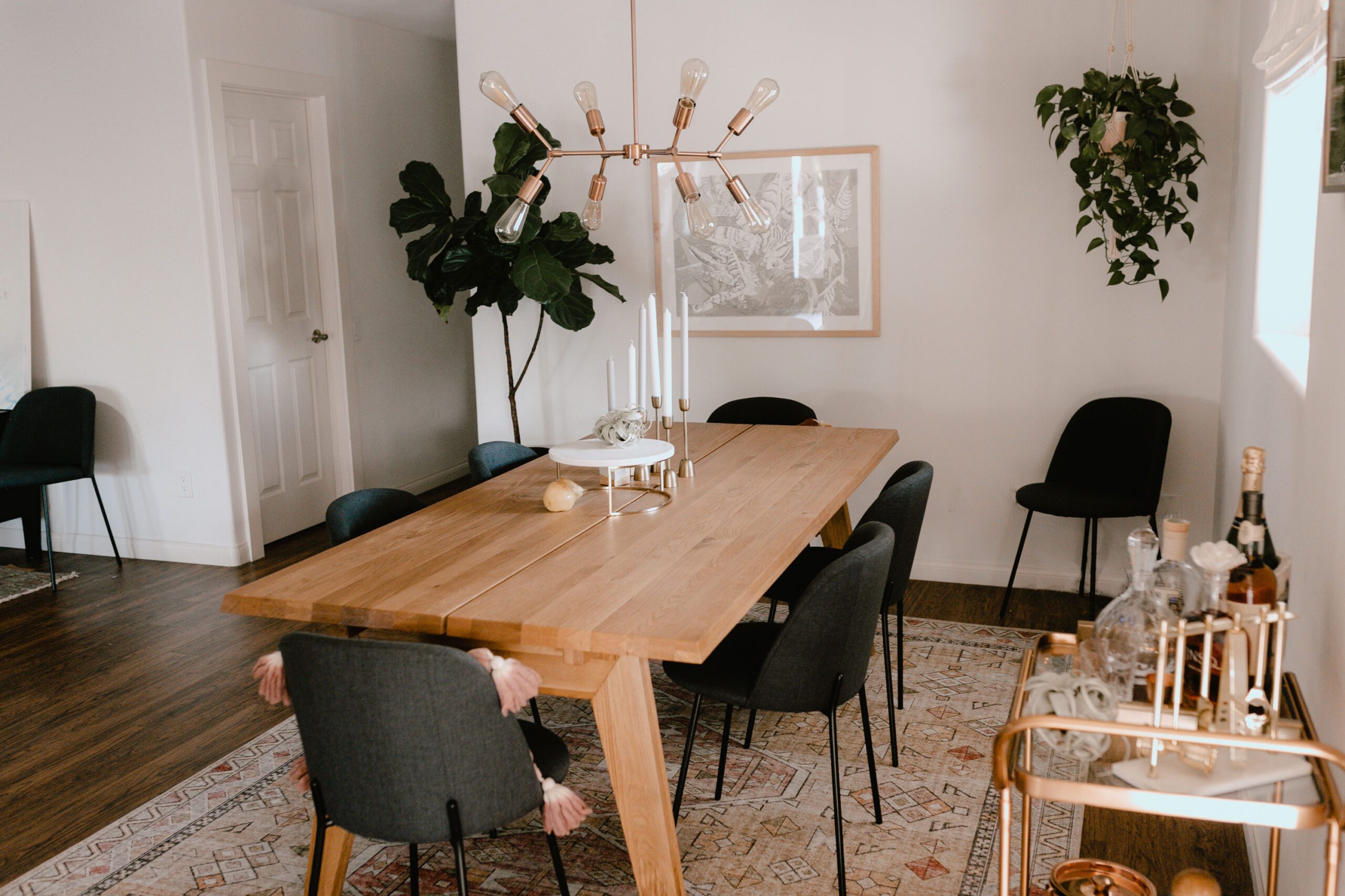 love the solid oak of this gorgeous dining table from article. #theldlhome #article #moderndiningroom