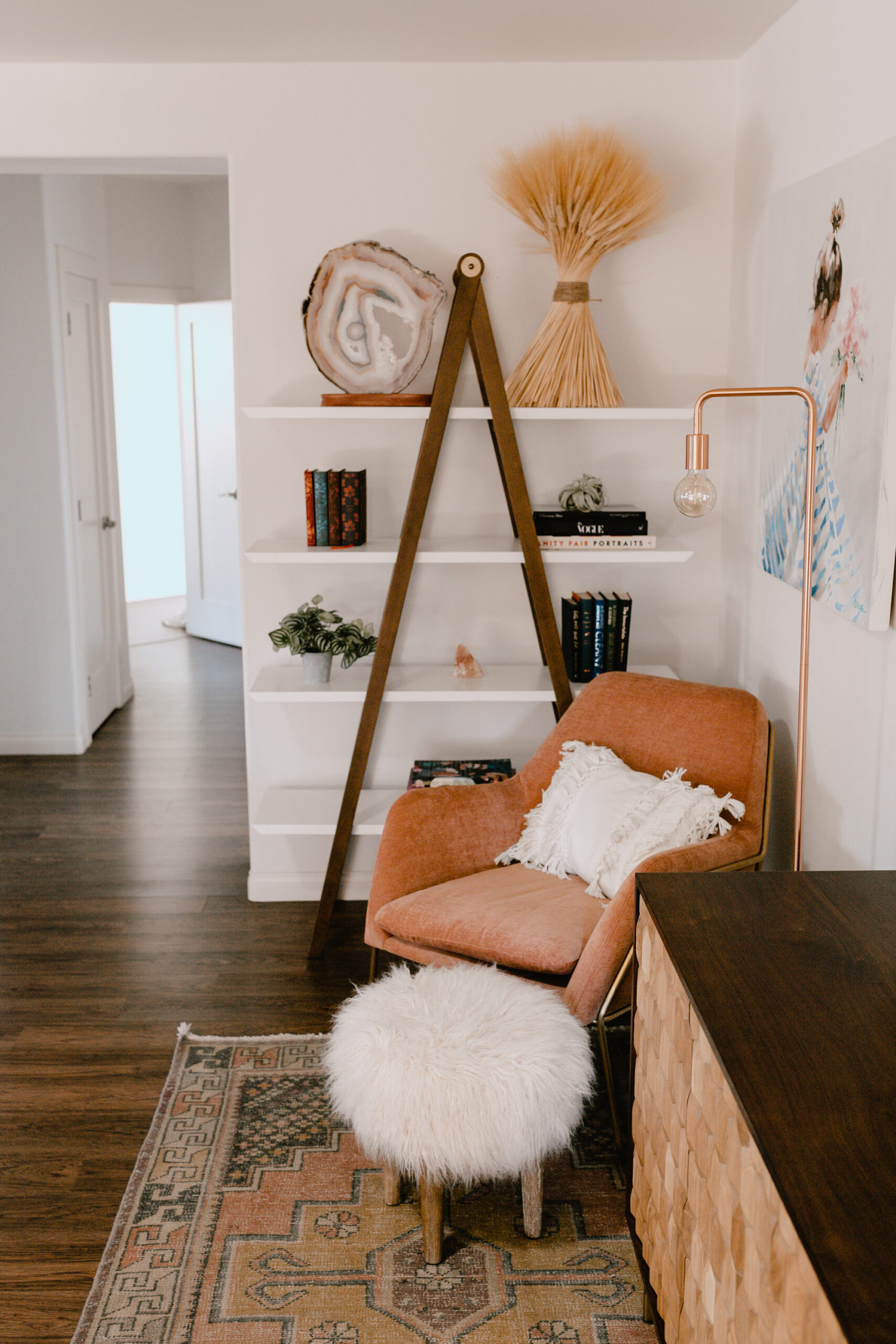 love this beautiful bookshelf from article in the awkward corner of our older home. #thelovedesignedlife #theldlhome #livingroom #cornerchair #bookshelf
