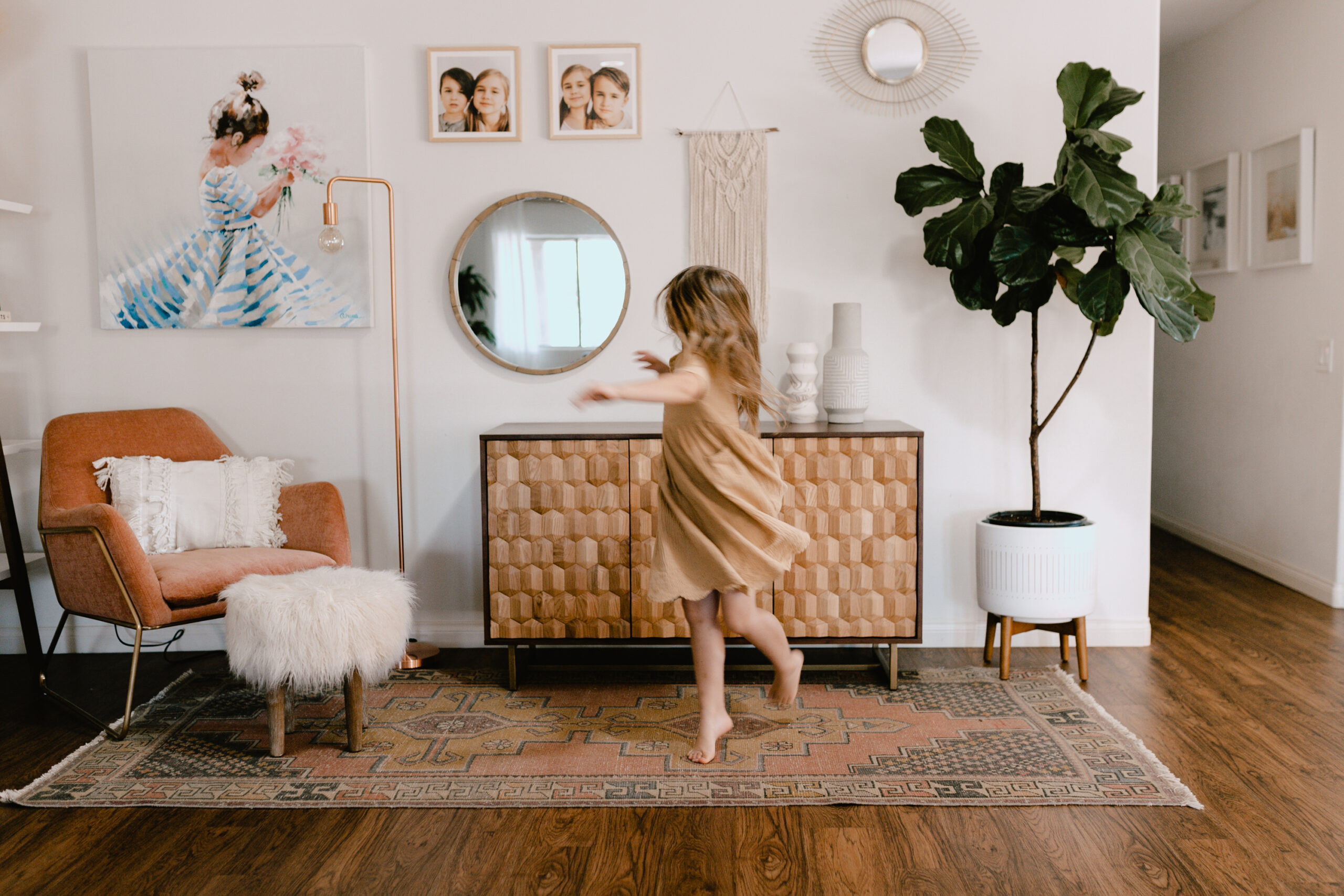 un updated corner with a beautiful dining buffet and a twirling little girl. #theldlhome #homedesign #beautifulspaces