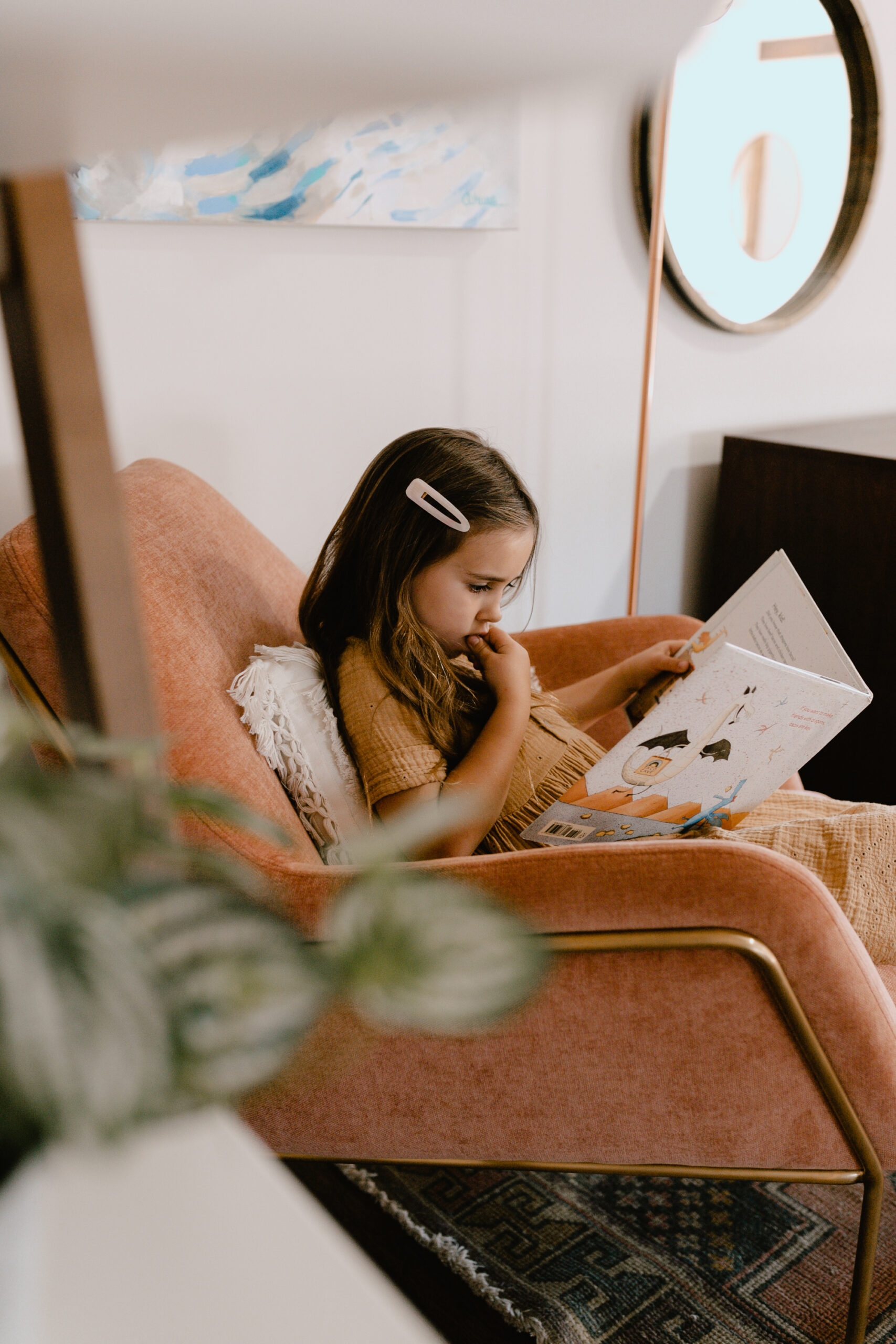 sweet girl reading in the pink forma chair from article #theldlhome #formachair #mybohoabode