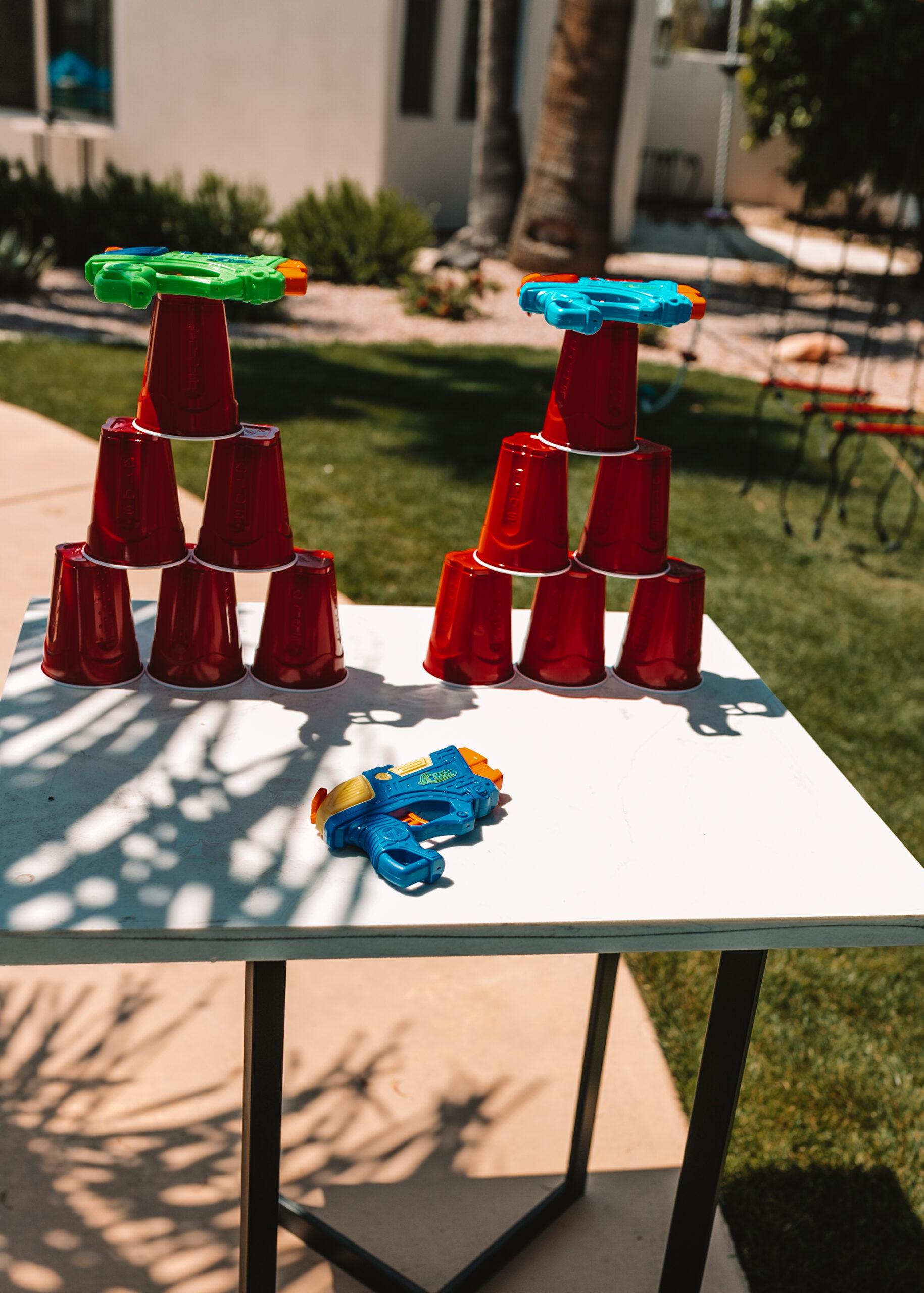 water gun cup tower shooting game. #outdoorfun #thelovedesigendlife #backyardwatergames