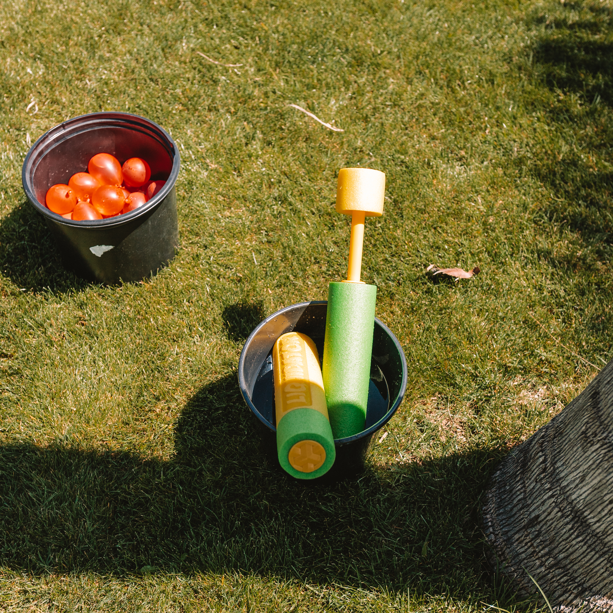fill the bucket with these water squirters. #outdoorgames #backyardfun #watergames