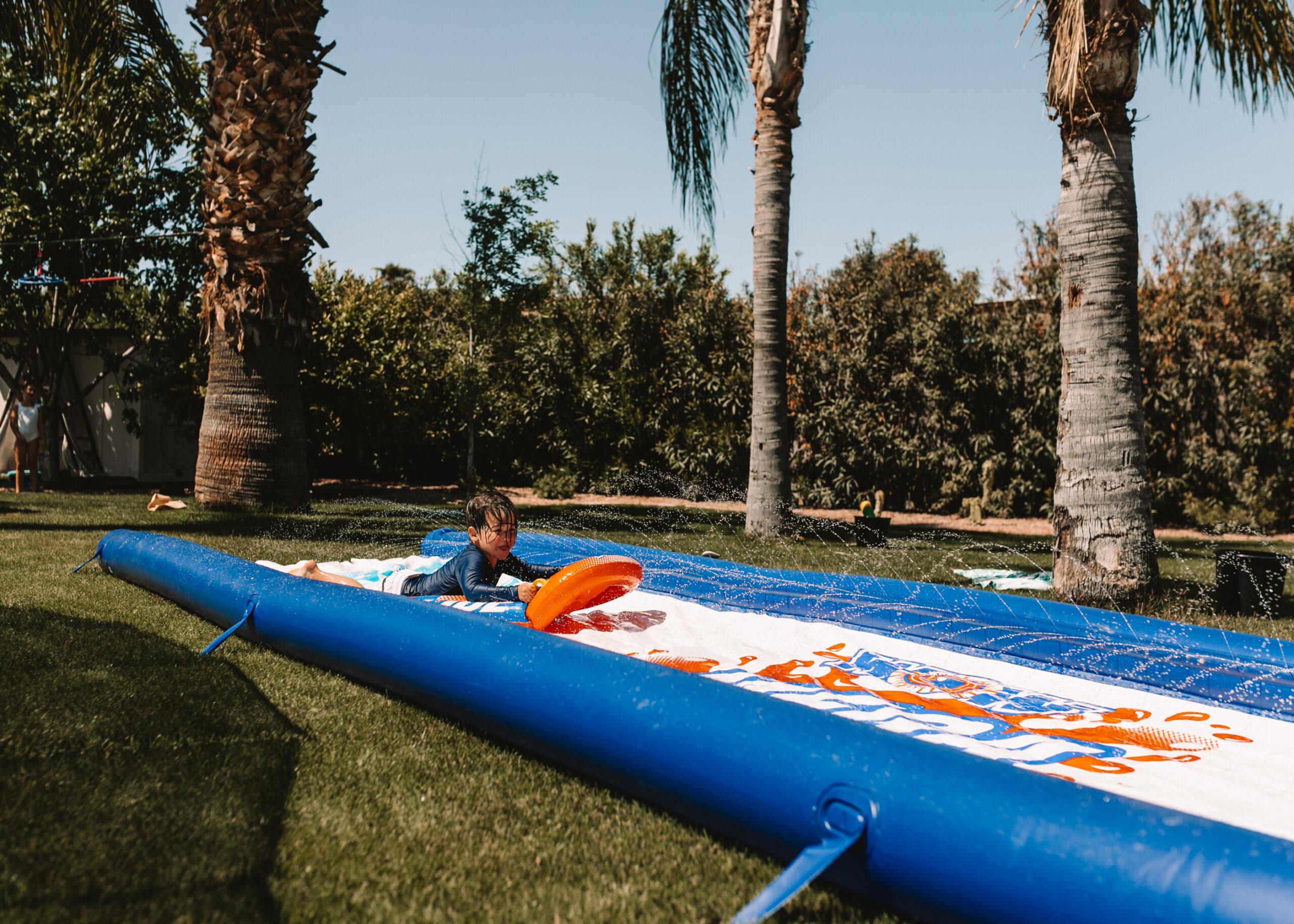 slip and slide water fun for our backyard field day! #slipandslide #backyardfun #waterplay #fieldday