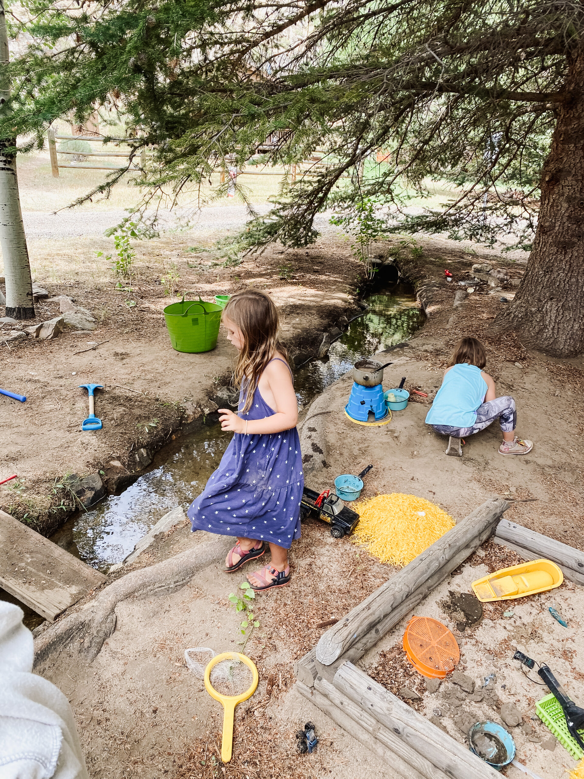 making mud pies in the ditch. #camping #mudpies #outdoorplay