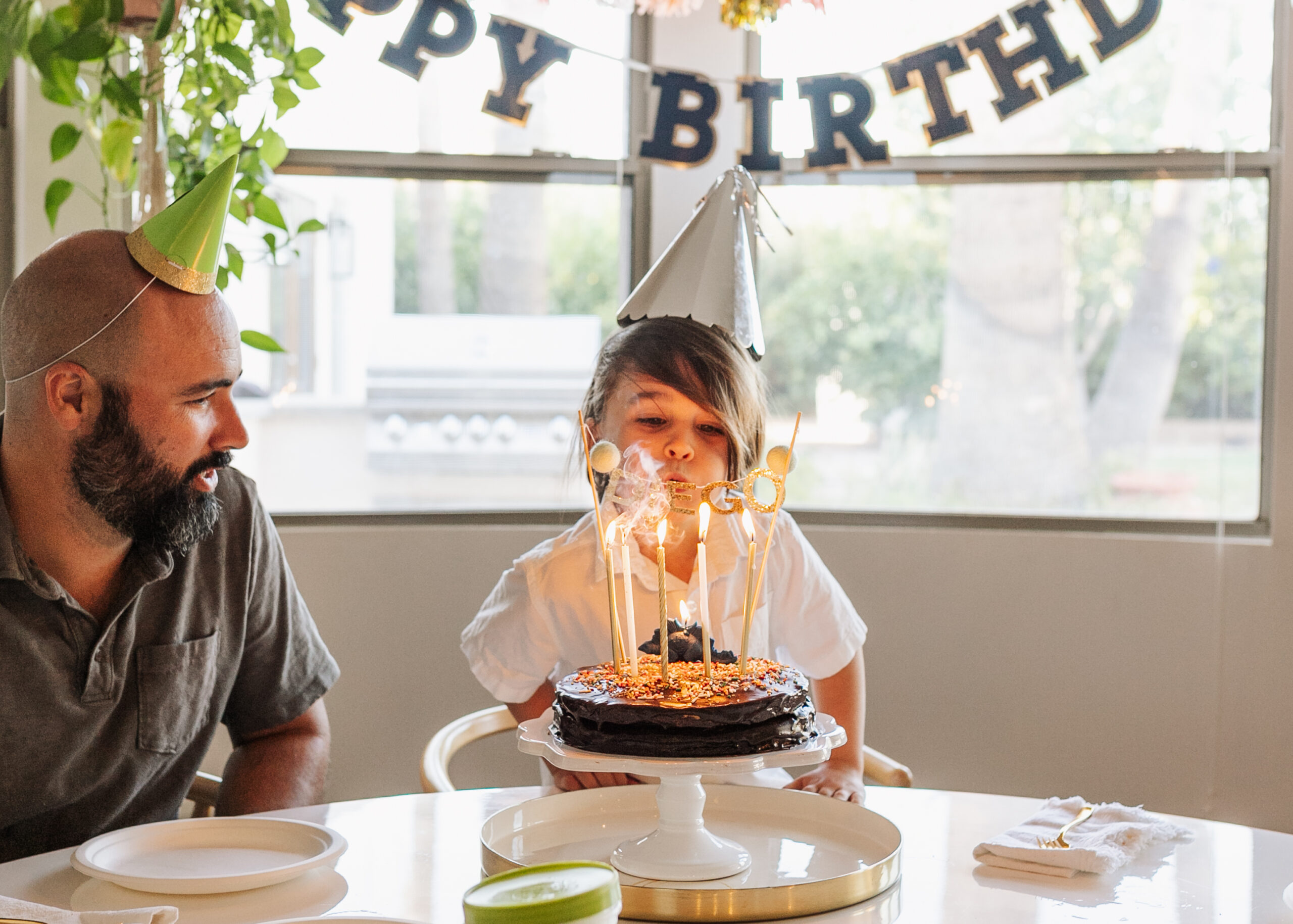 blowing out the candles on his homemade birthday cake! #thelovedesignedlife #glutenfreecake