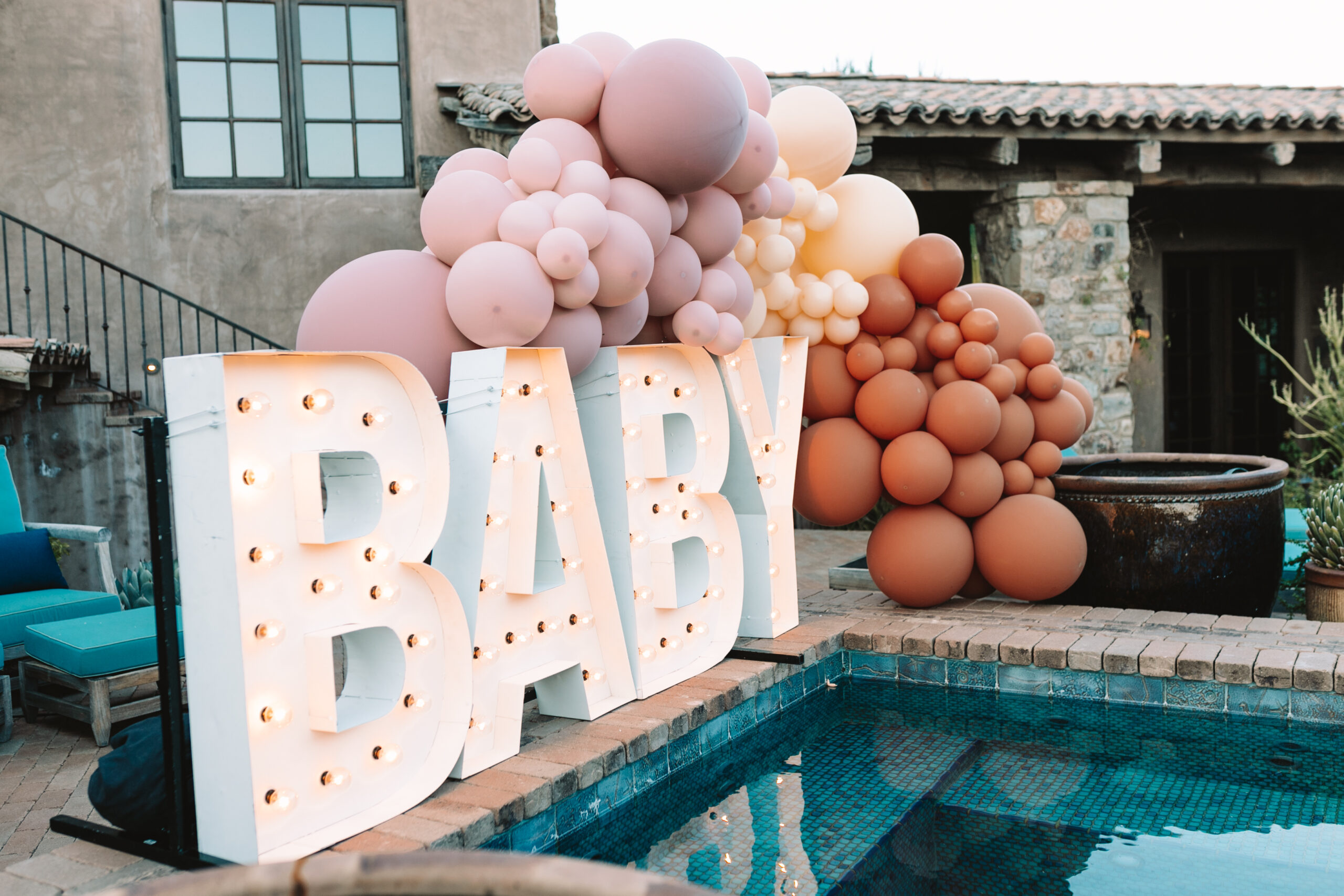 obsessed with these light up letters by Alpha Lit Phoenix with the balloon garland #lightupletters #bubblehustle #alphalit #babyshowerideas