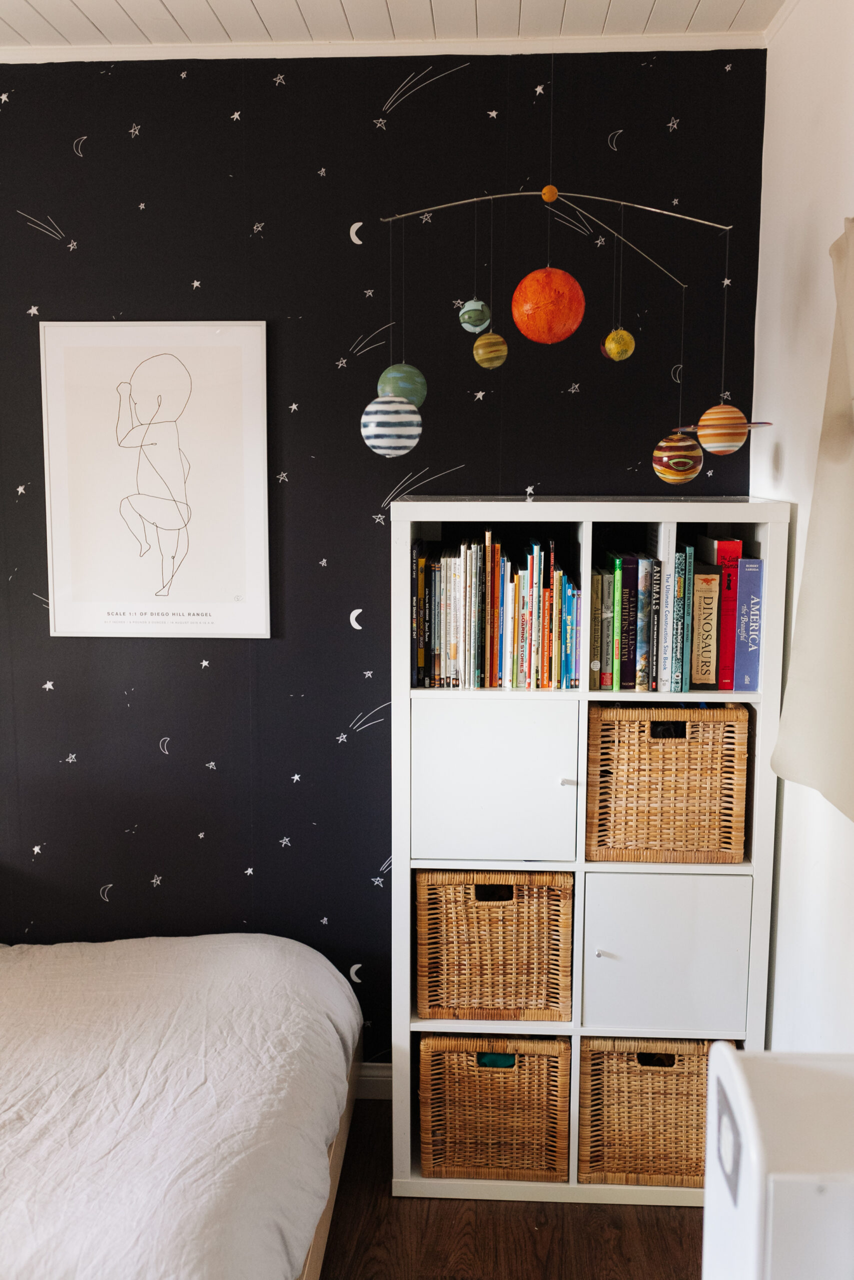 a cozy reading nook and play area for our big boy's space bedroom #boysroom #kidsroom #spacebedroom