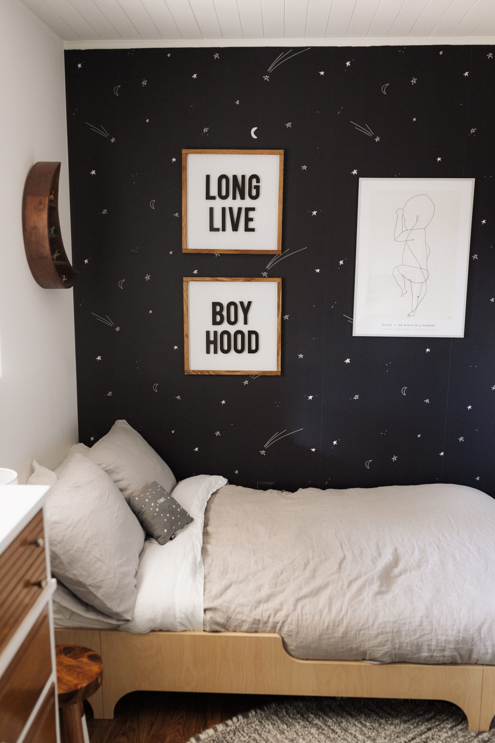 a space inspired bedroom for my big boy! I love how the wallpaper makes him feel like he is immersed in space, while cozy in his bedroom. #spaceinspiredbedroom #bigboyroom #boysbedroom #homedesign