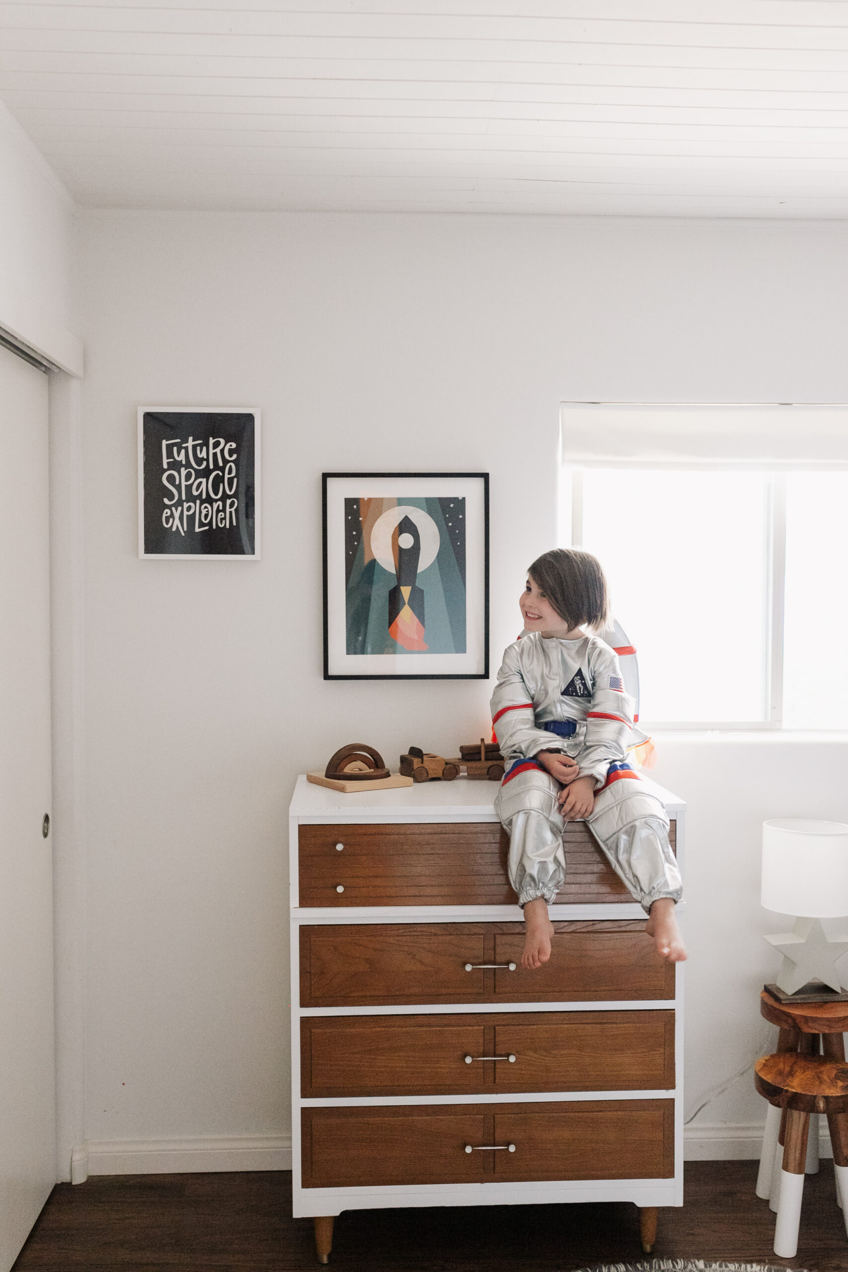 this artwork from minted perfectly complements the wallpaper in our space-inspired big boy room! #theldlhome #bedroom #kidsroom #outerspace