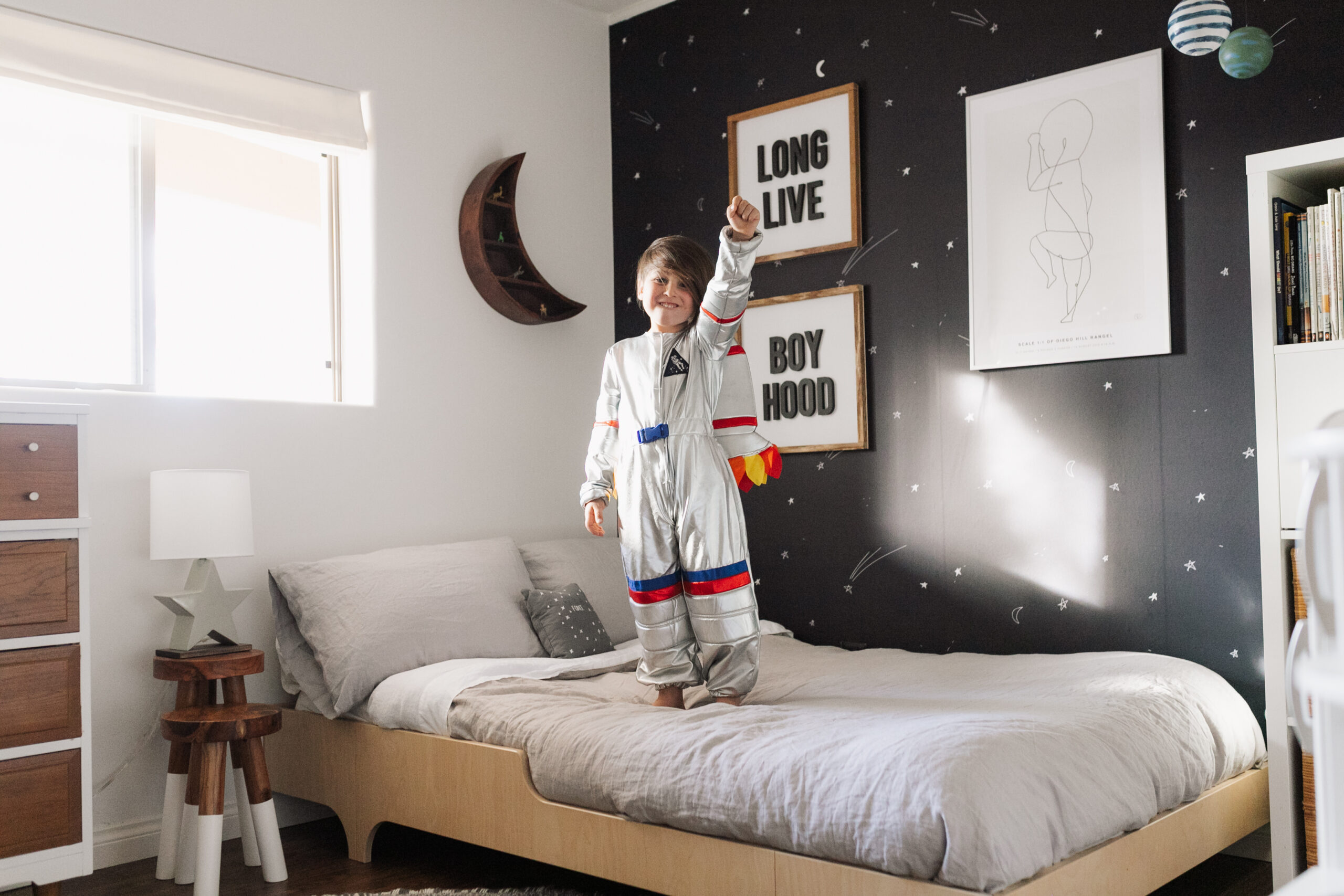 long live boyhood with this cute little future astronaut! blast off with his space inspired room details today on thelovedesignedlife.com #theldlhome #thelovedesignedlife #astronaut #kidsroom #bigboyroom