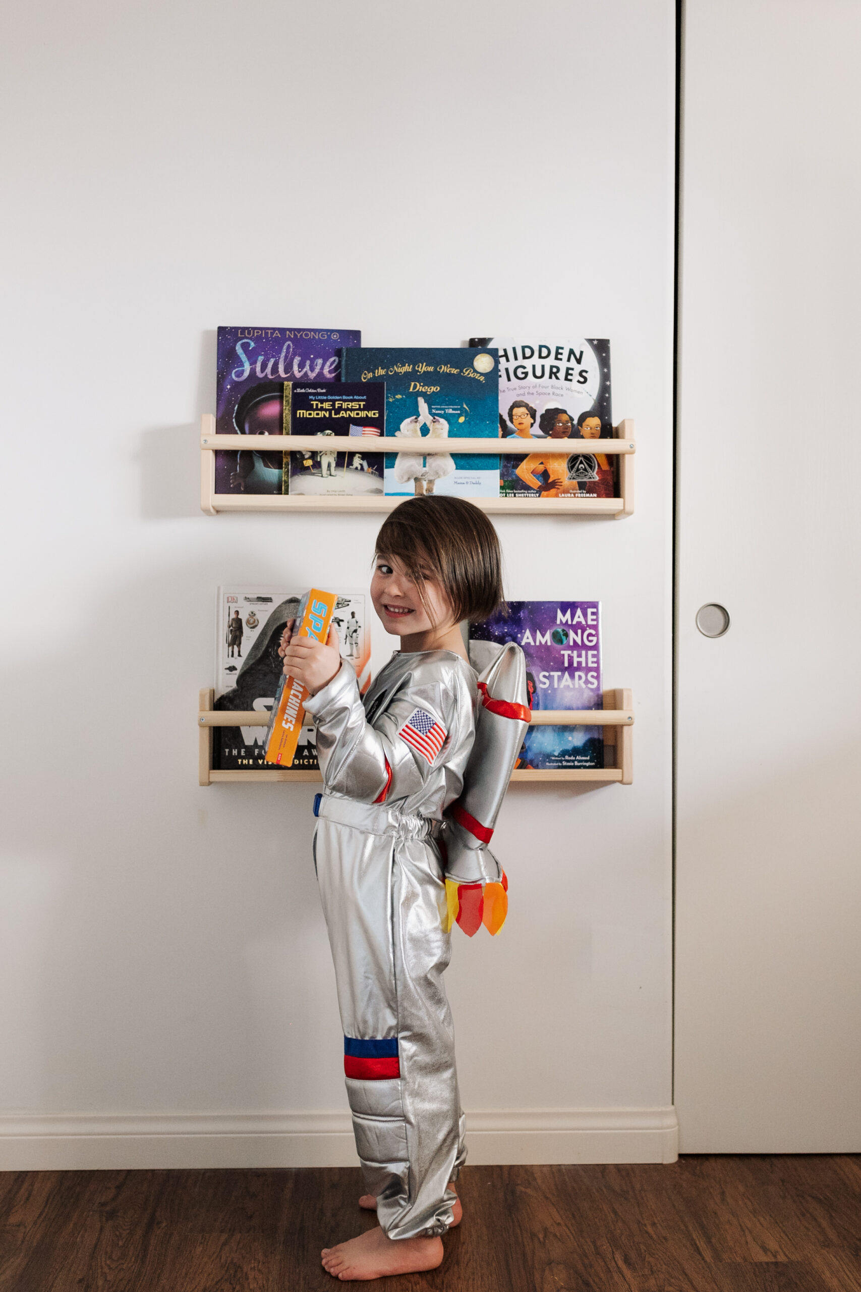 his little book nook with some of our favorite space books #theldlhome #thelovedesignedlife #spaceroom #kidsroom #kidsspaceroom #astronaut