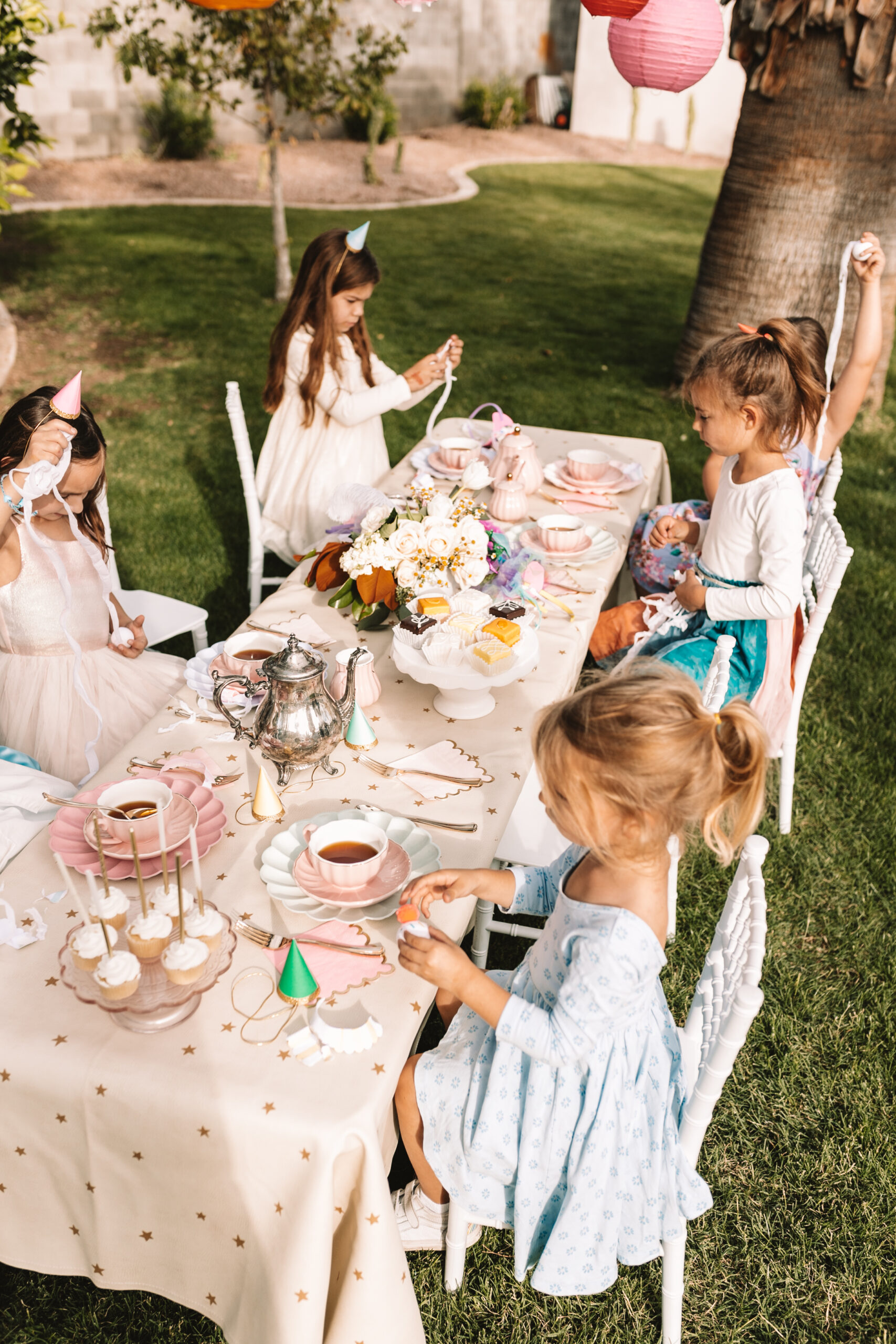 a very merry unbirthday tea party with mini cakes and real tea #thelovedesignedlife #teaparty #minicakes #petitfours