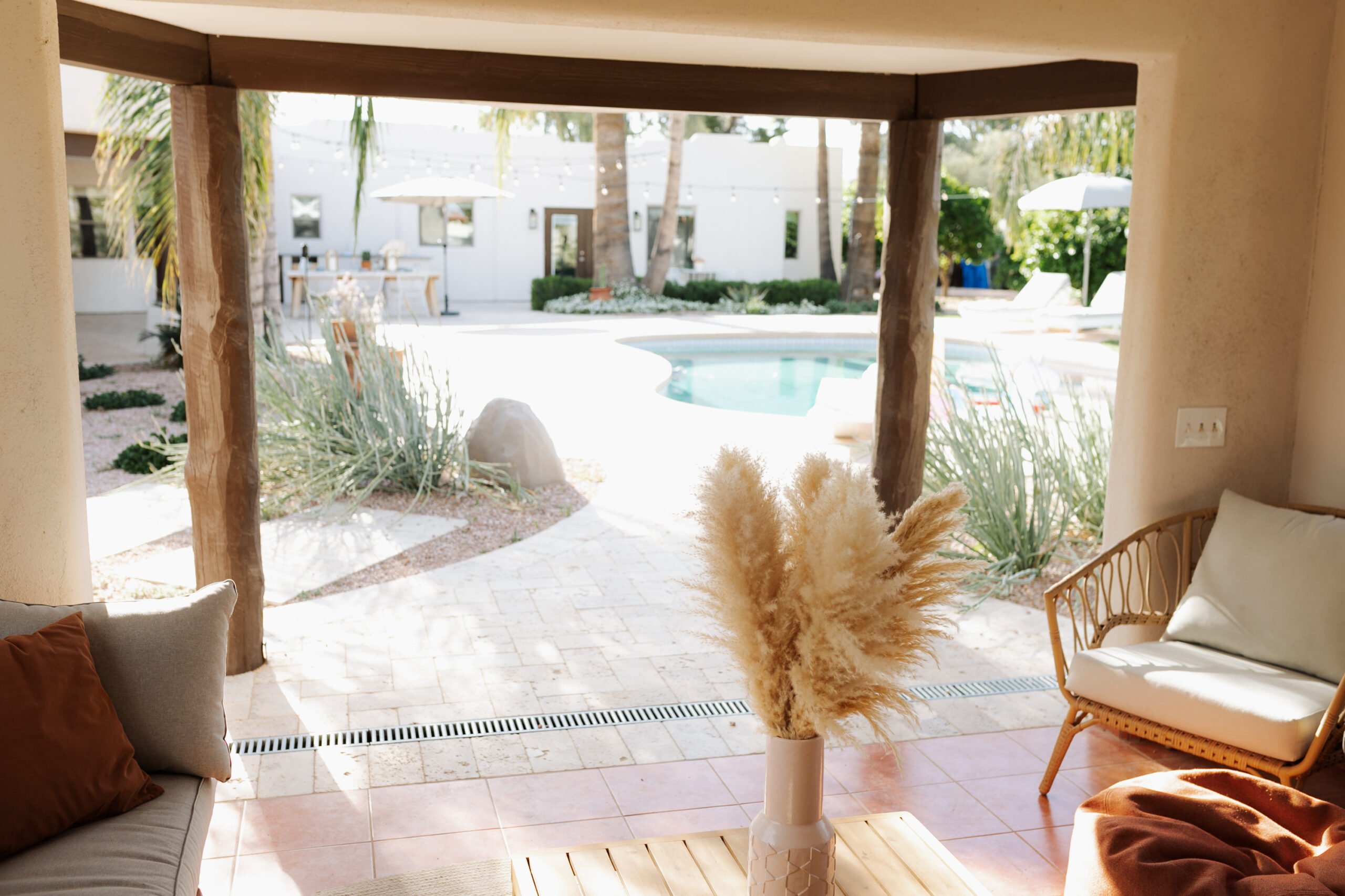 the view from our pool ramada, with modern furniture and a beachy boho vibe #modernbackyard #arizonaliving #poolramada #backyarddesign